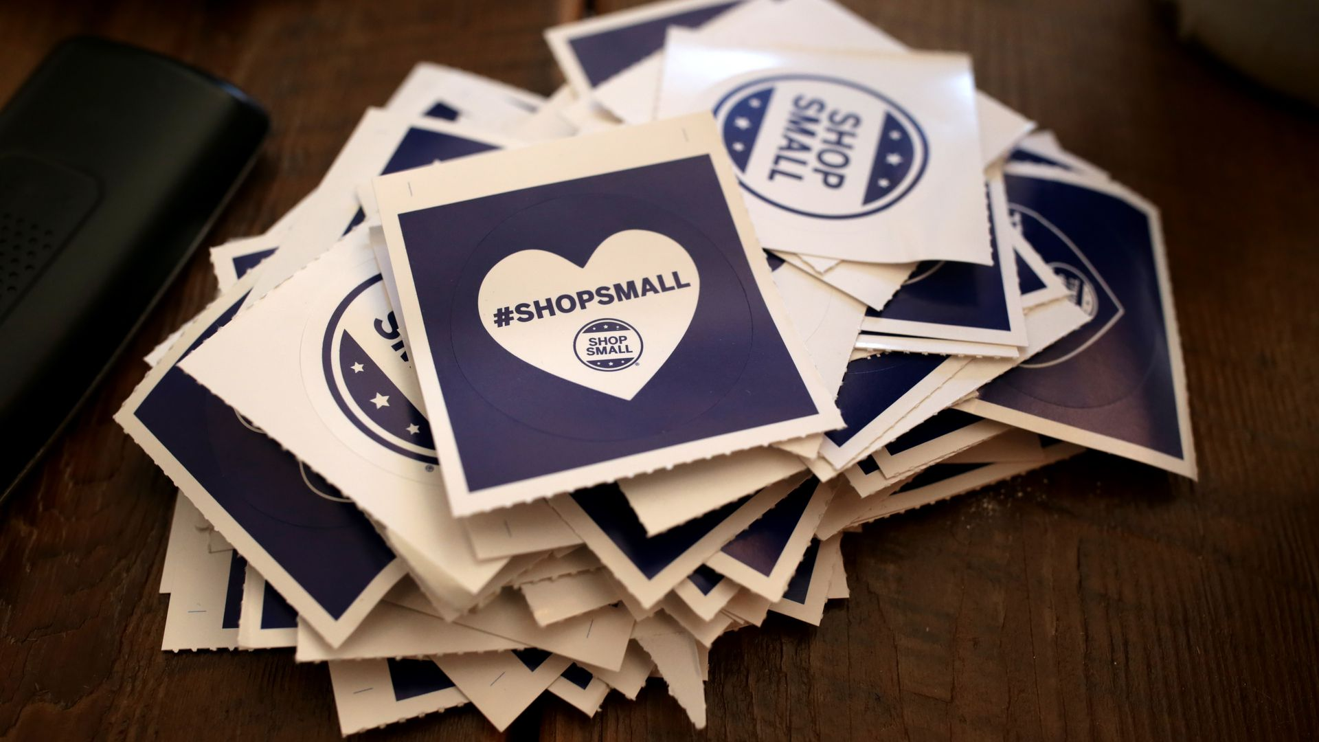 BROOKLINE, MA - NOVEMBER 25: #ShopSmall stickers are pictured at the Boston General Store in Coolidge Corner in Brookline, MA on Small Business Saturday