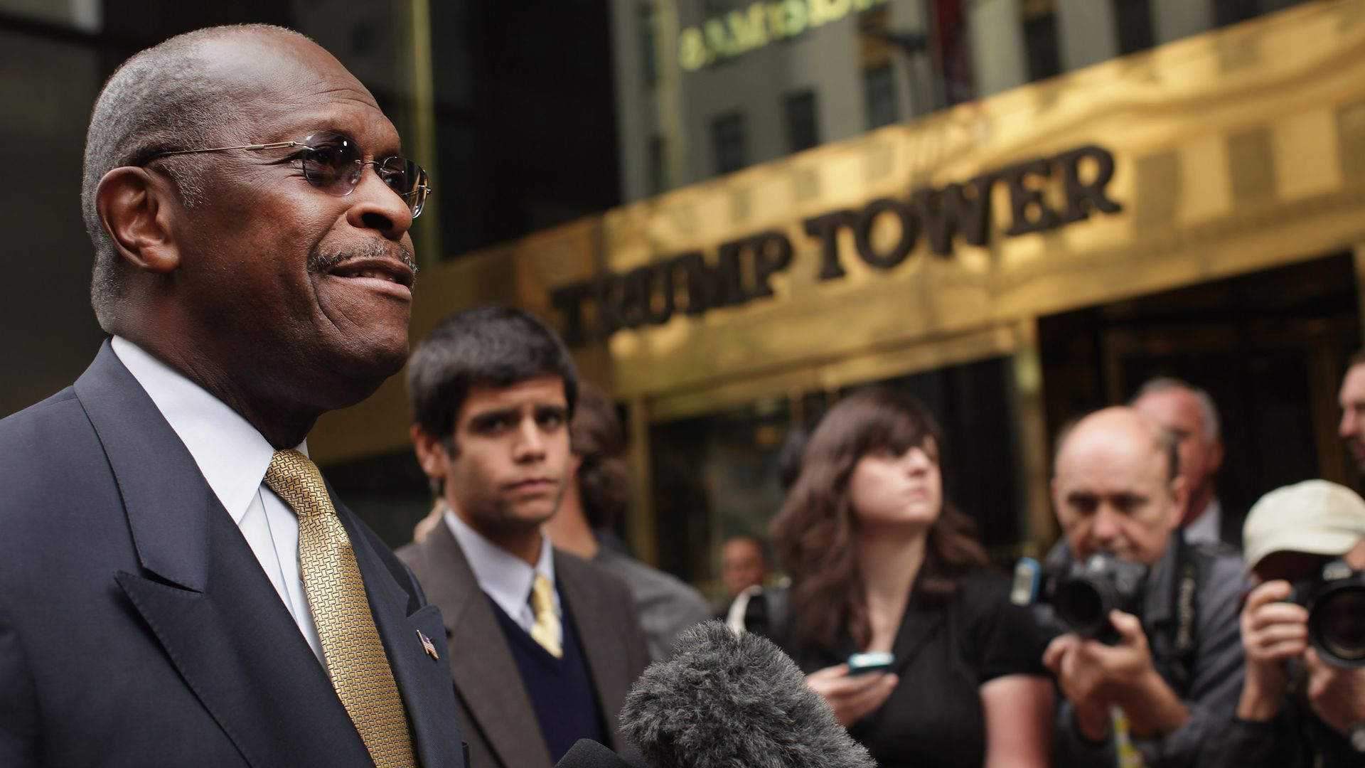 Herman Cain speaks to reporters in front of Trump Tower.