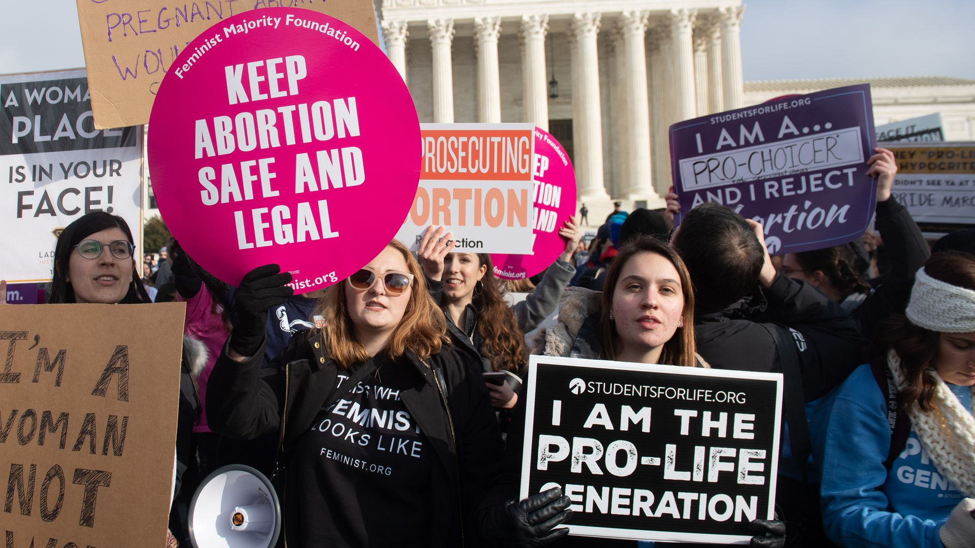 Pro-choice and anti-abortion activists protesting outside the U.S, Supreme Court.