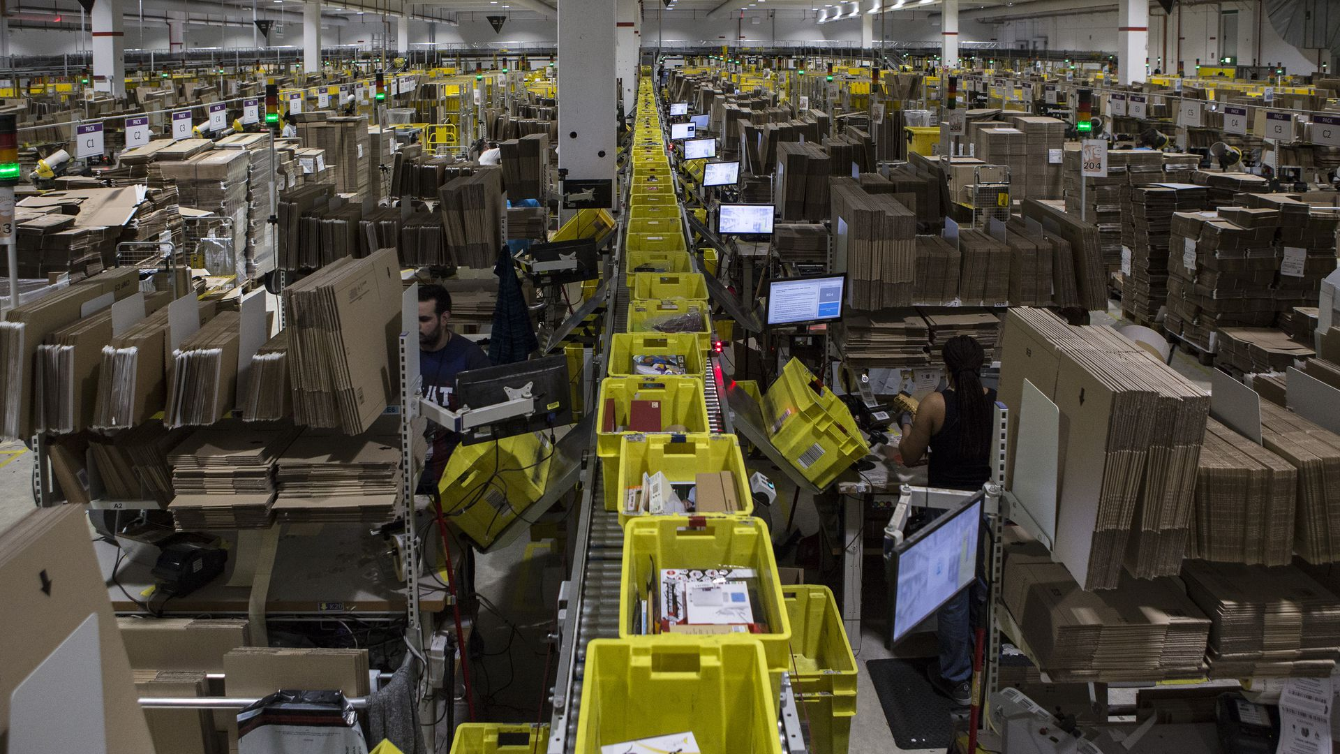 An assembly line of boxes in a warehouse