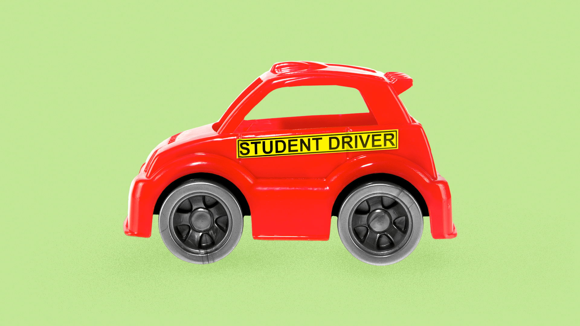 "Illustration of a toy car with a ""Student Driver"" sticker across the side."