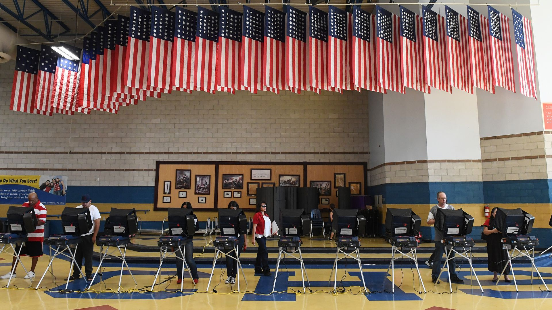 Voters cast their ballots at voting machines at Cheyenne High School on Election Day on November 8, 2016 in North Las Vegas, Nevada.