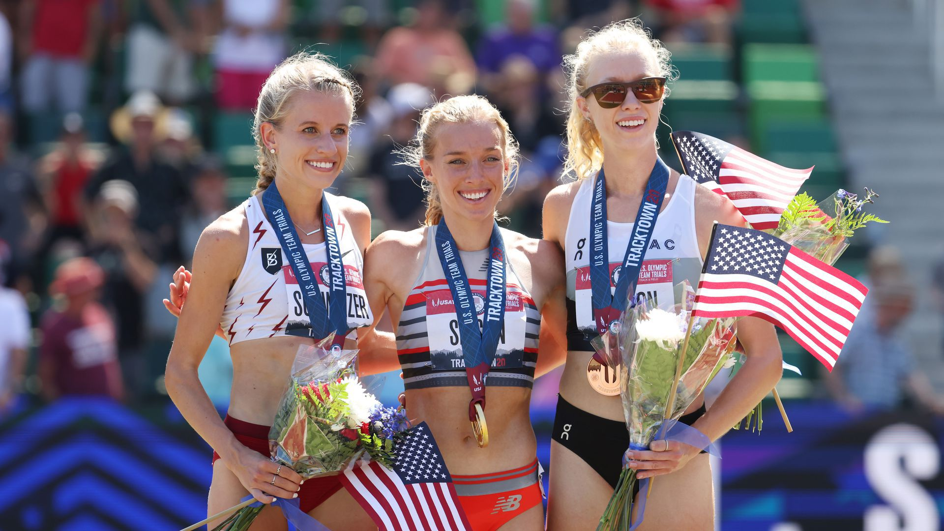 Karissa Schweizer, Emily Sisson and Alicia Monson, pose for a photo with their medals after the Women's 10,000 Meters Final at Hayward Field in Eugene, Oregon.