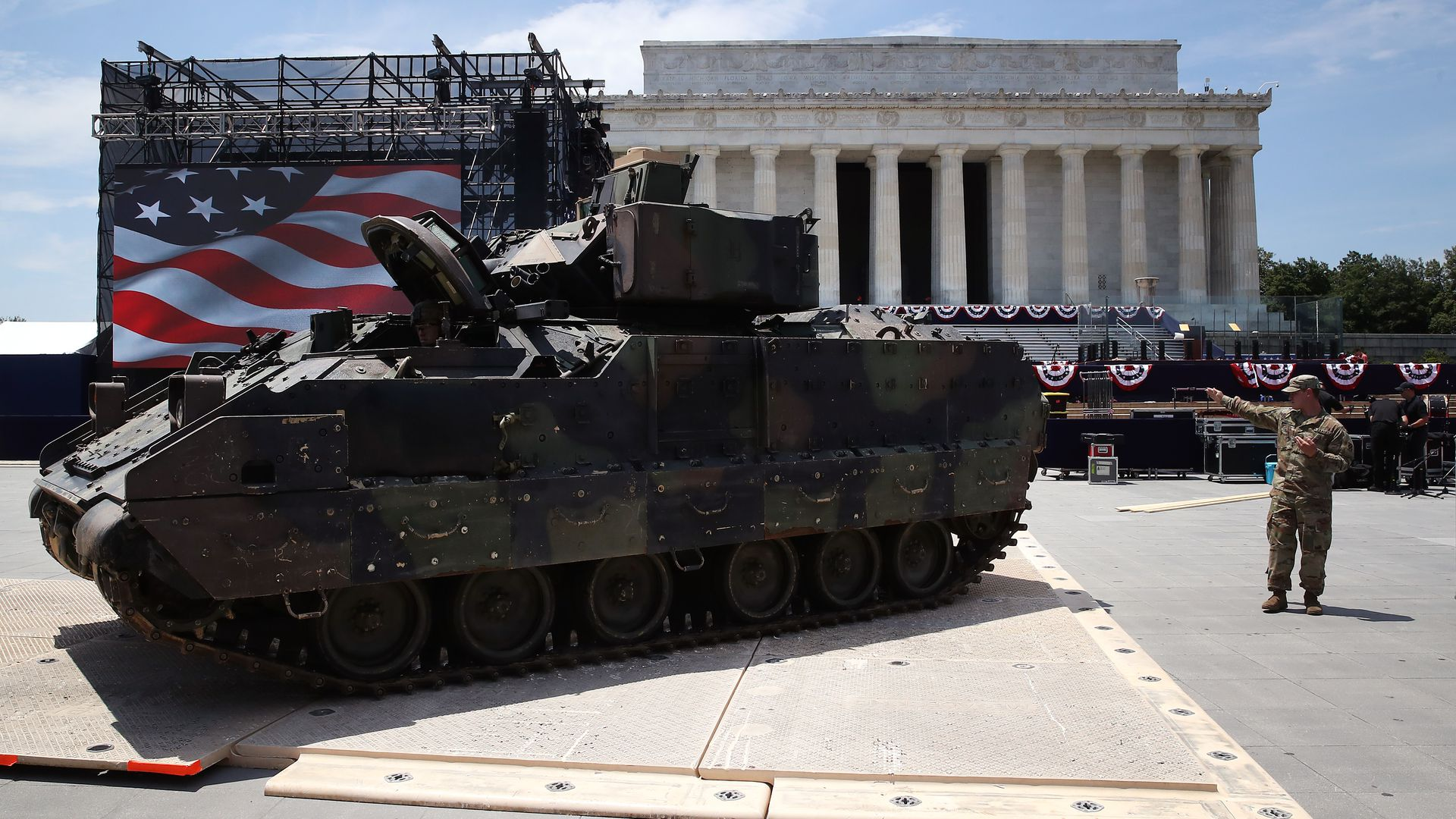 Members of the U.S. Army park an M1 Abrams tank in front of the Lincoln Memorial.
