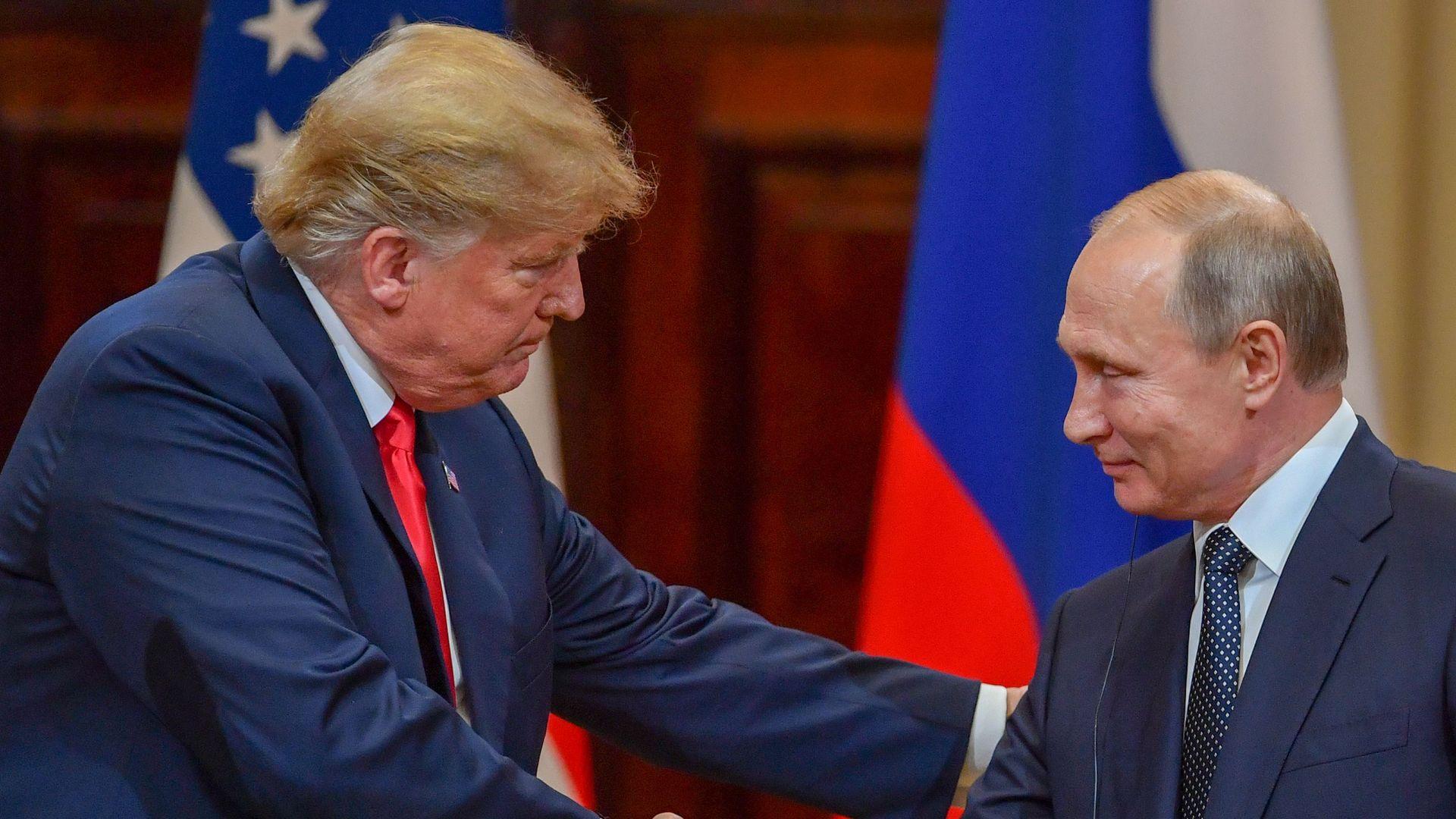 Trump shaking hands with Putin