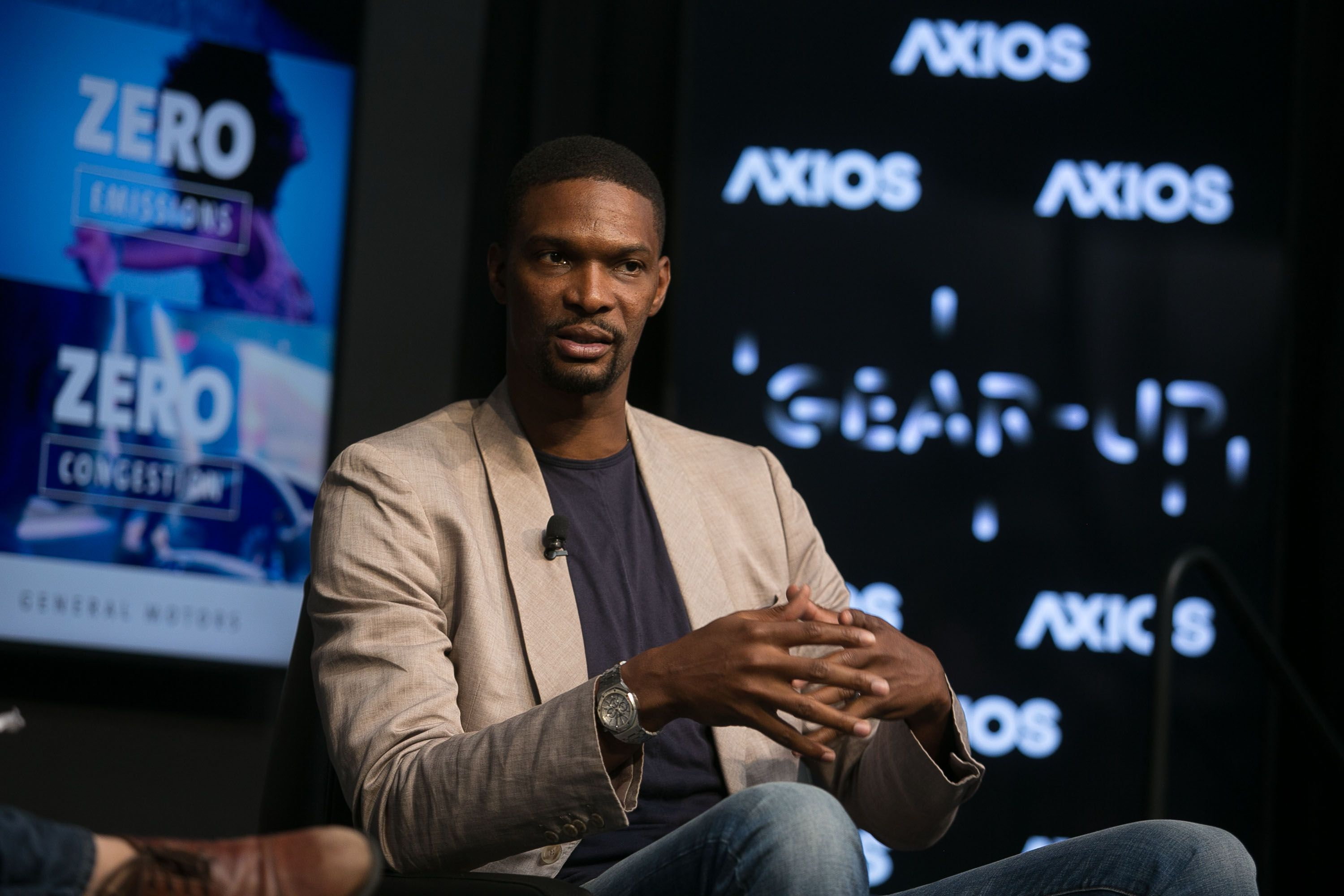 Chris Bosh explaining his passion for tech and innovation in an on-stage interview.