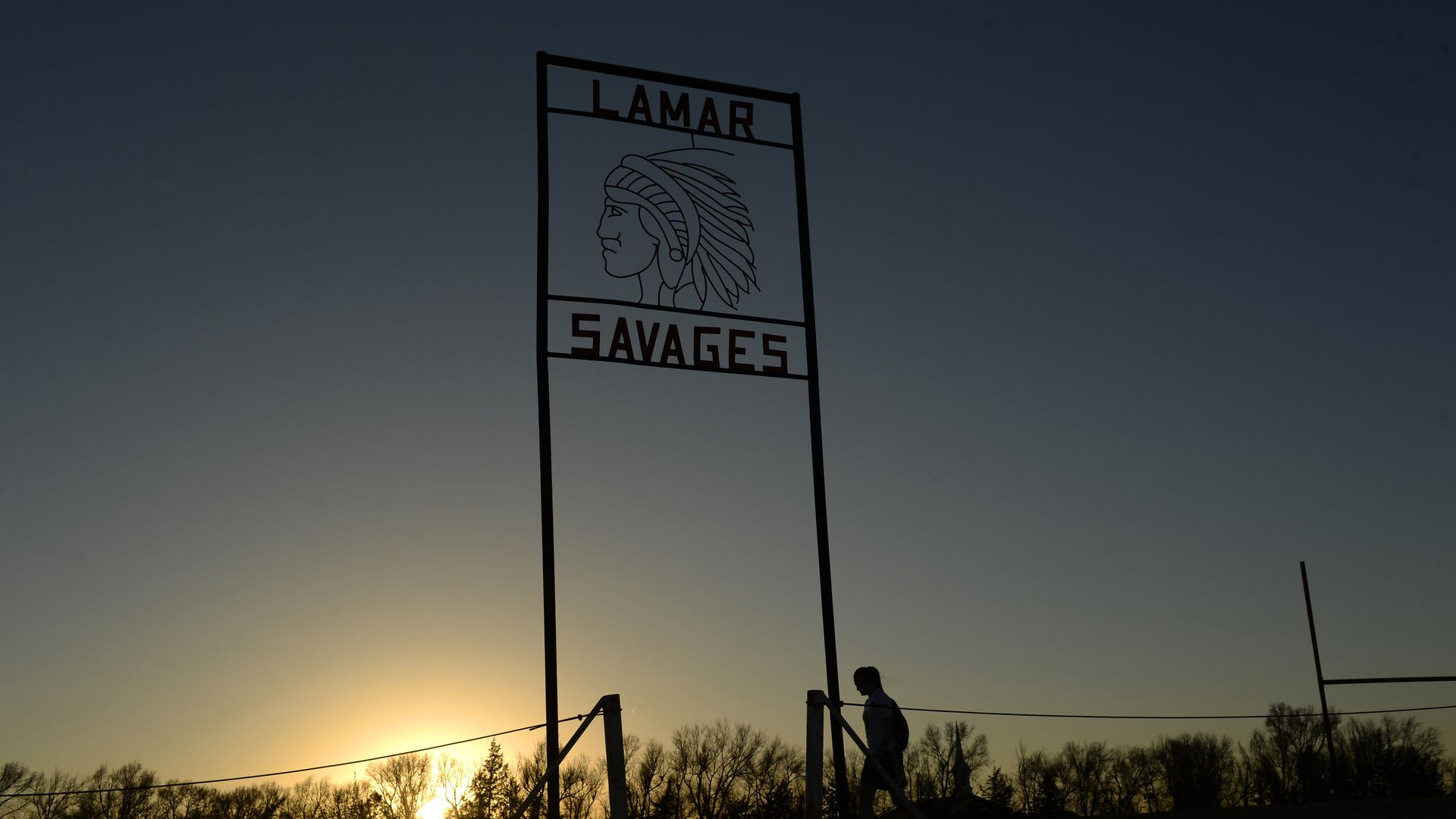 """A photo of the sign at Lamar High School that features a symbol of a Native American man and reads """"Lamar Savages"""""""