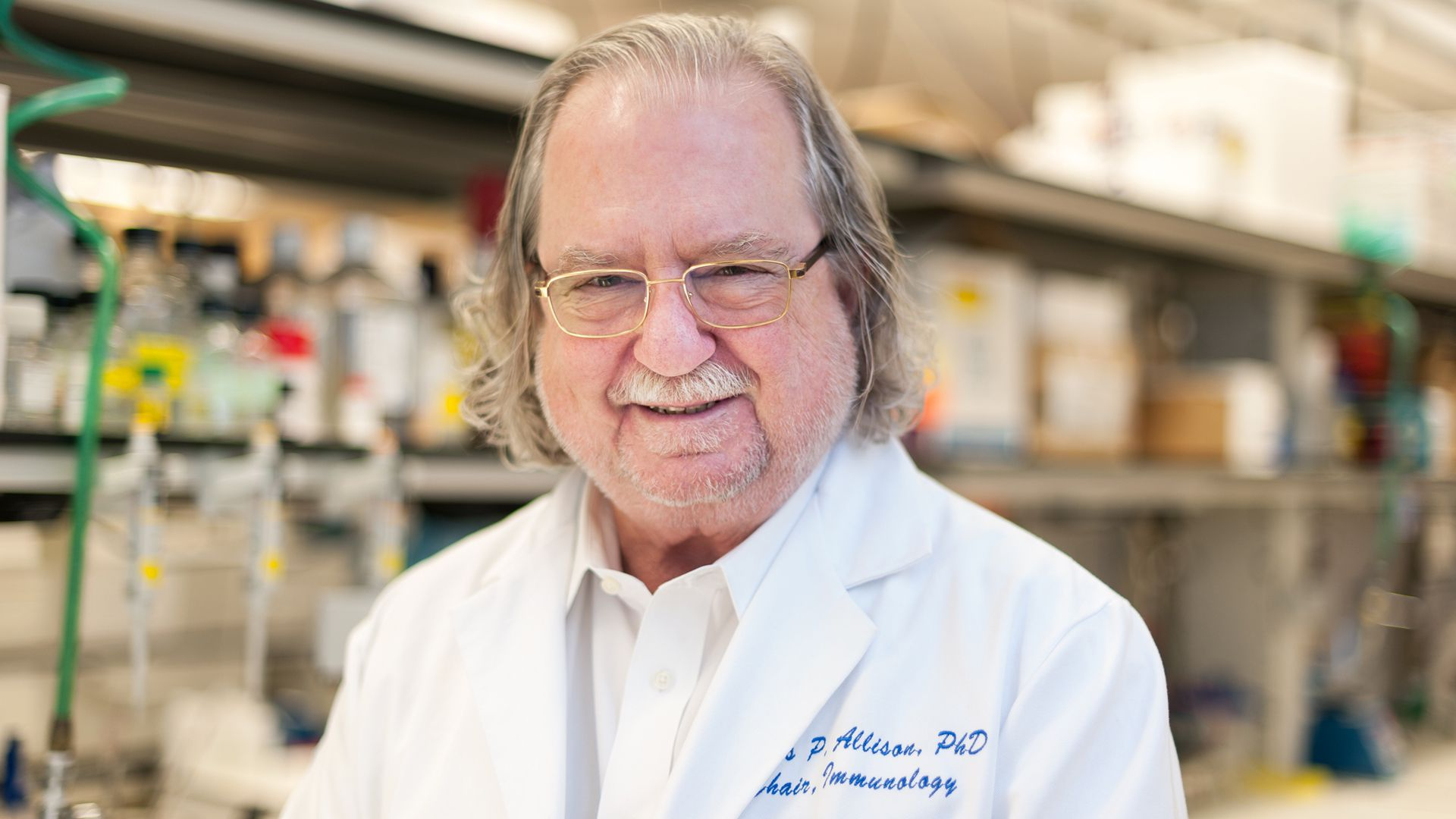 Photo of Jim Allison, who won the 2018 Nobel Prize, in his lab coat.
