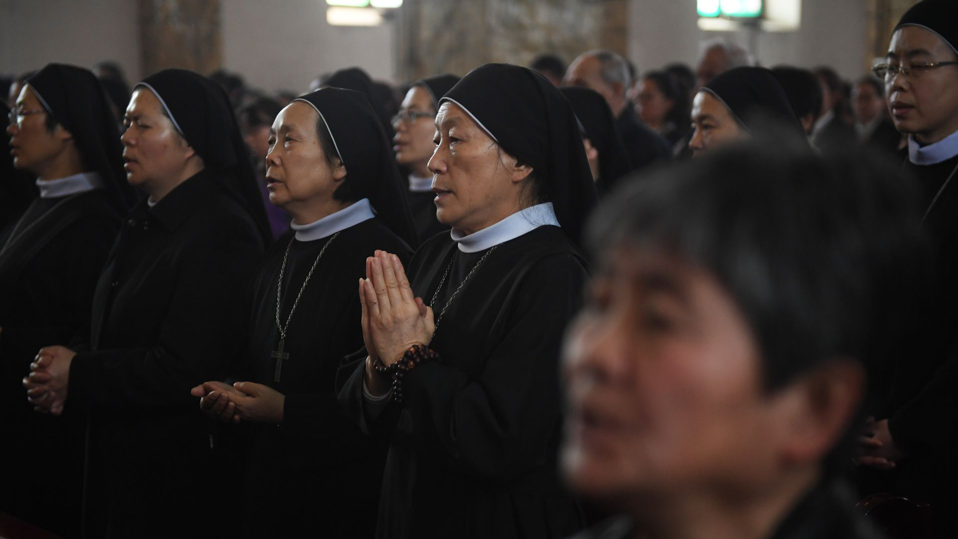 Catholic nuns at mass.