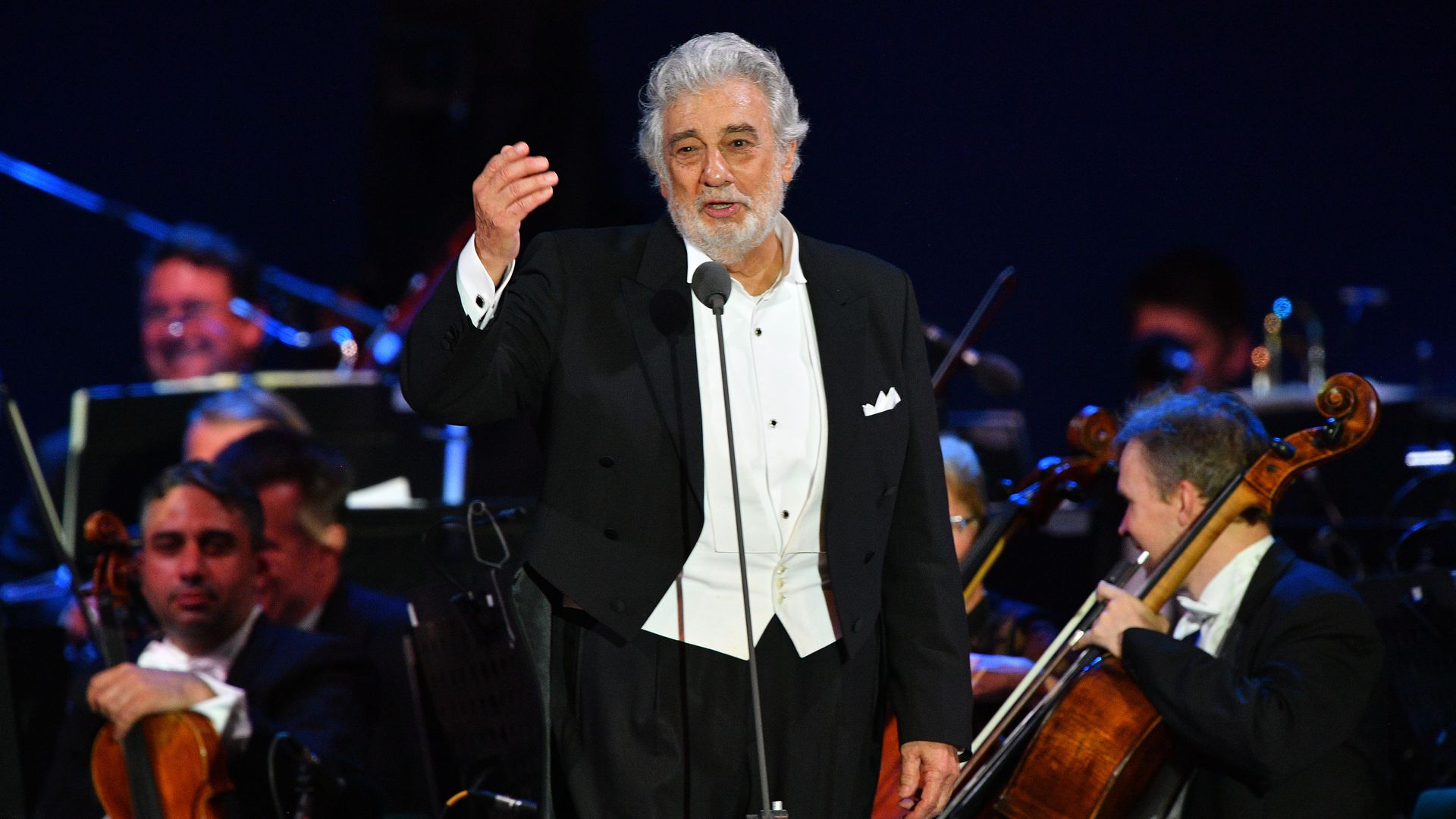 Spanish tenor Placido Domingo gestures as he performs during his concert in the newly inaugurated sports and culture centre 'St Gellert Forum' in Szeged, southern Hungary