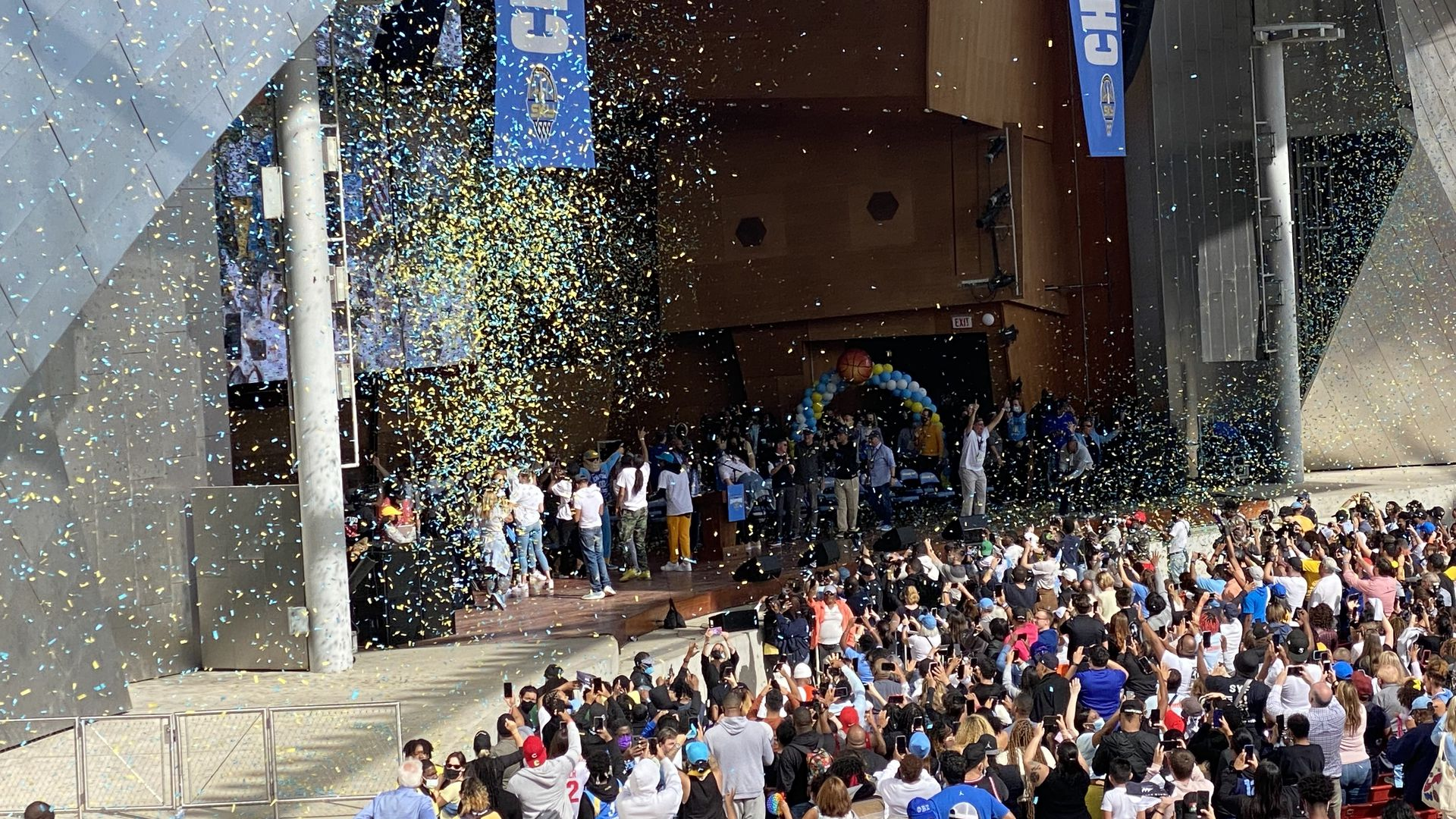 Confetti is dropped all over the stage at a championship rally.