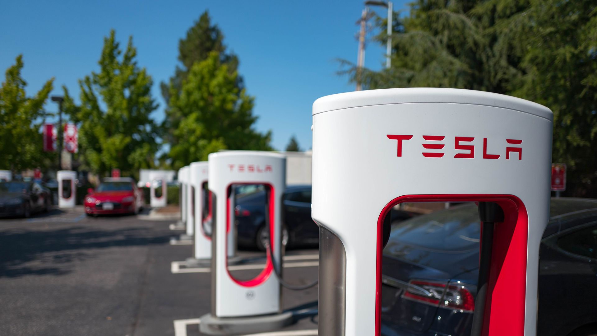 Photo of Tesla electric car chargers in a parking lot.