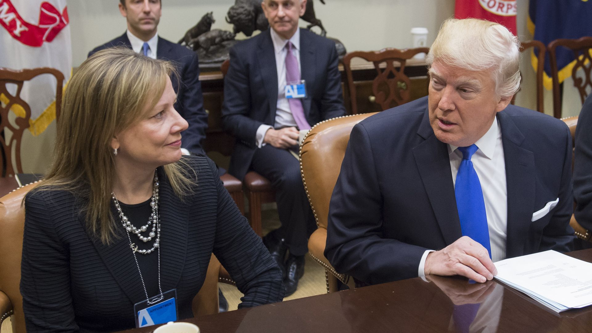 US President Donald Trump speaks with General Motors CEO Mary Barra during a meeting with automobile industry leaders in the Roosevelt Room of the White House in Washington, DC, January 24, 2017.