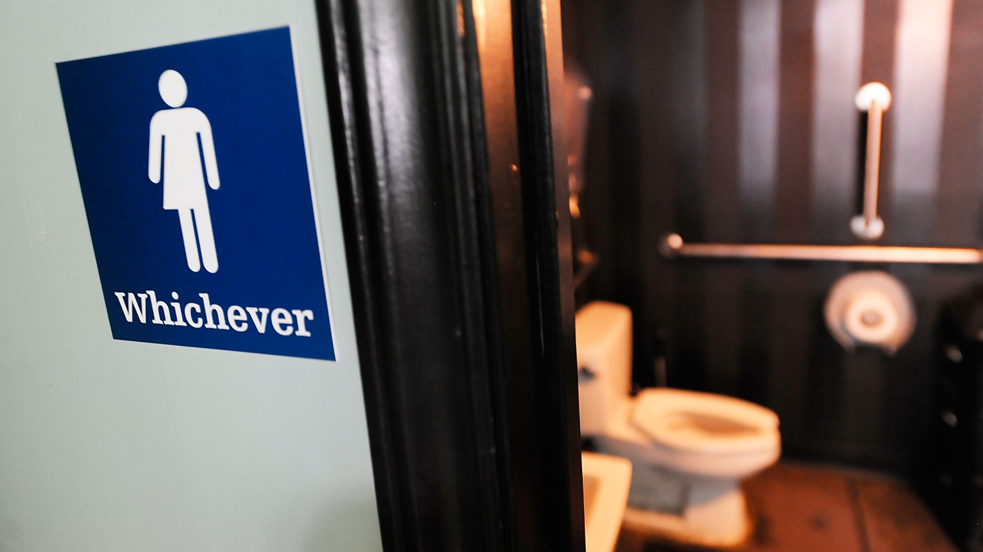 A gender neutral sign posted outside a bathroom at Oval Park Grill in Durham, North Carolina. Photo: Sara D. Davis/Getty Images