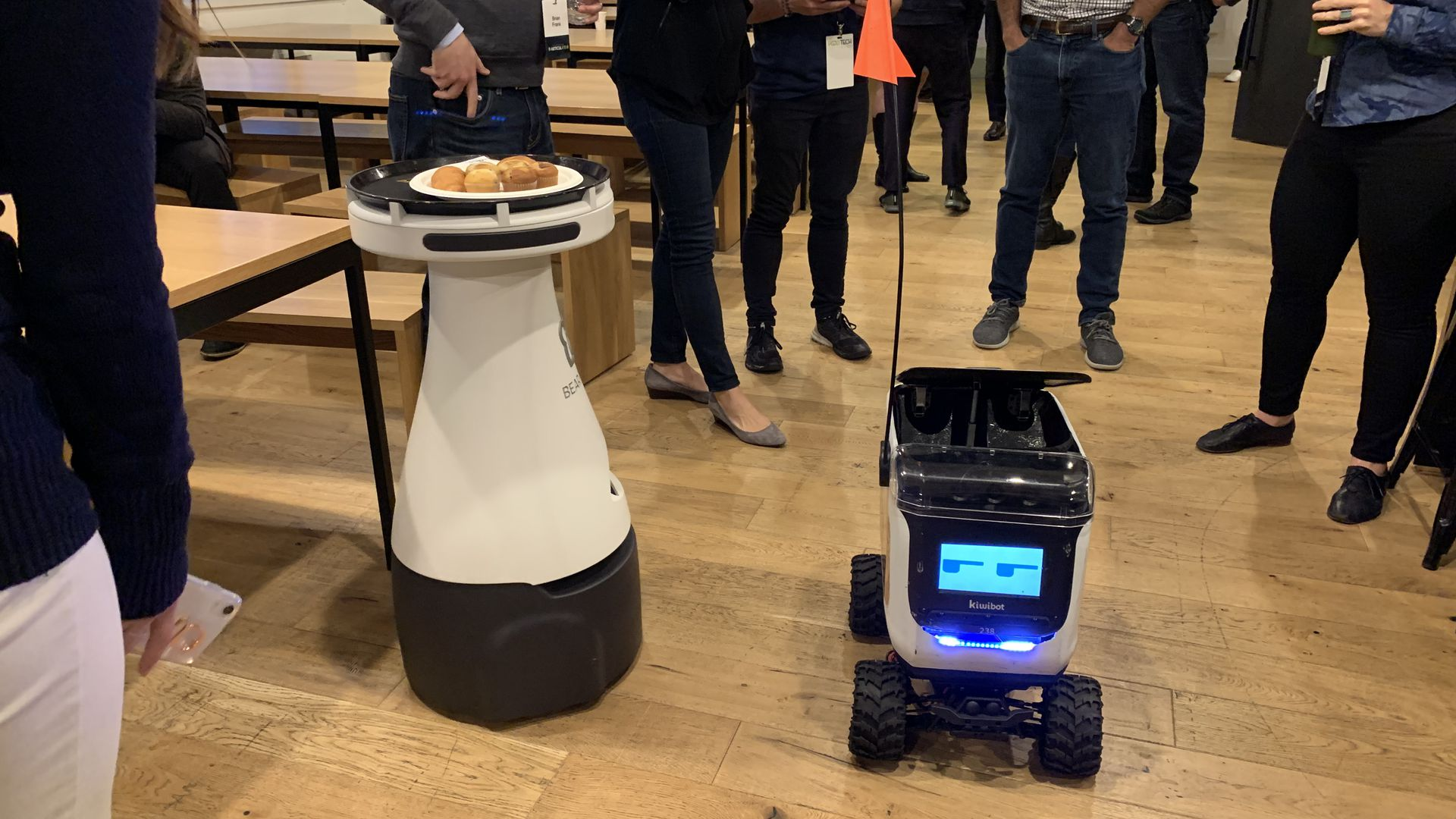 Photo of two food delivery bots