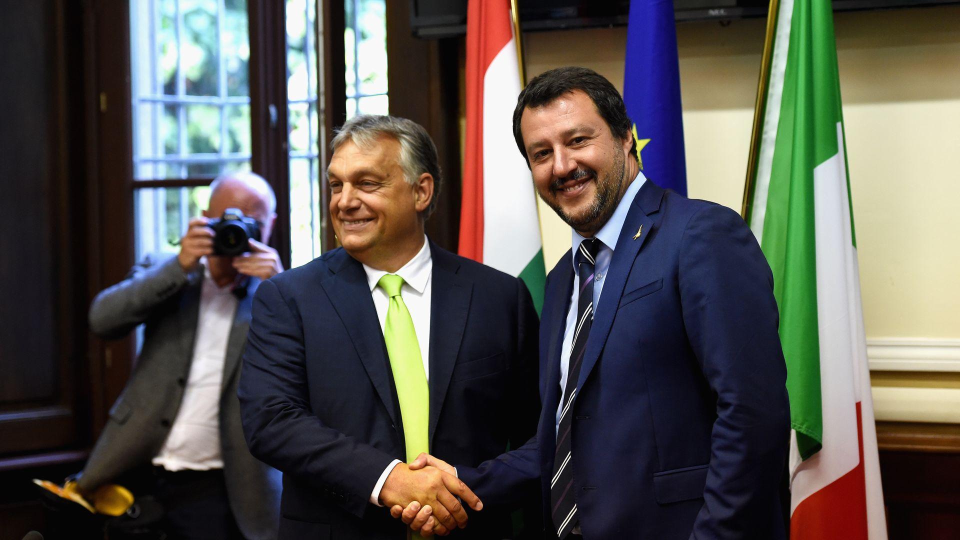 Viktor Orban and Matteo Salvini shaking hands