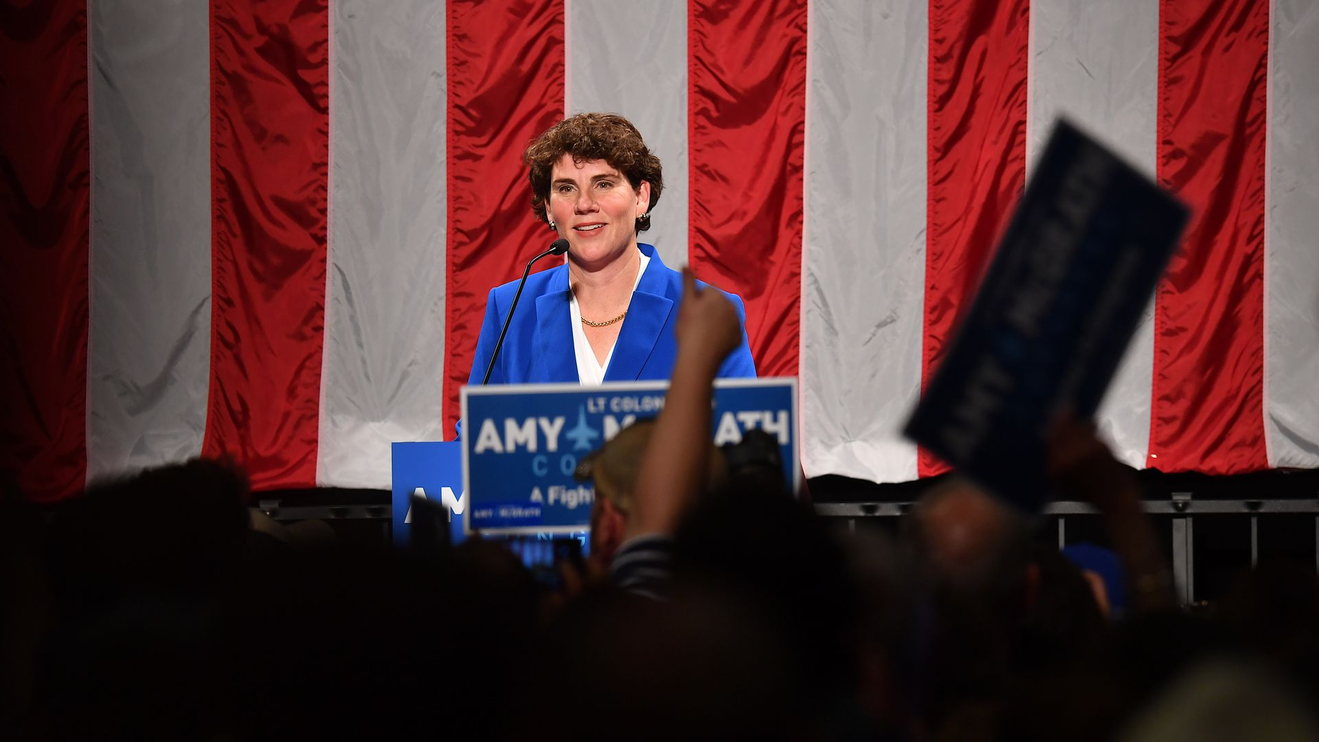 Amy McGrath smiles before campaign crowd.