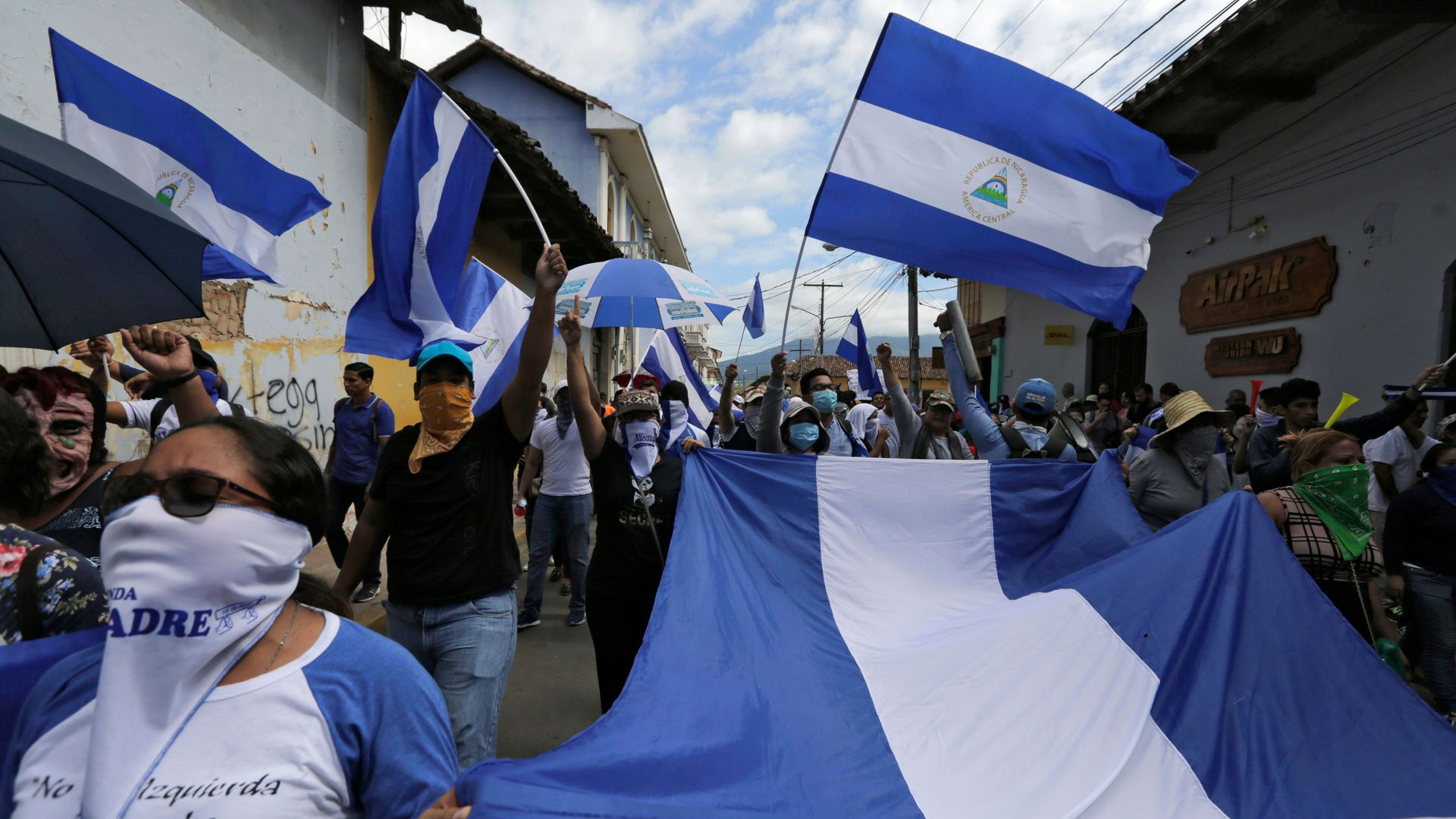 Anti-government protesters take part in a march dubbed 'United Nicaragua will never be defeated' in Granada, Nicaragua on August 25, 2018