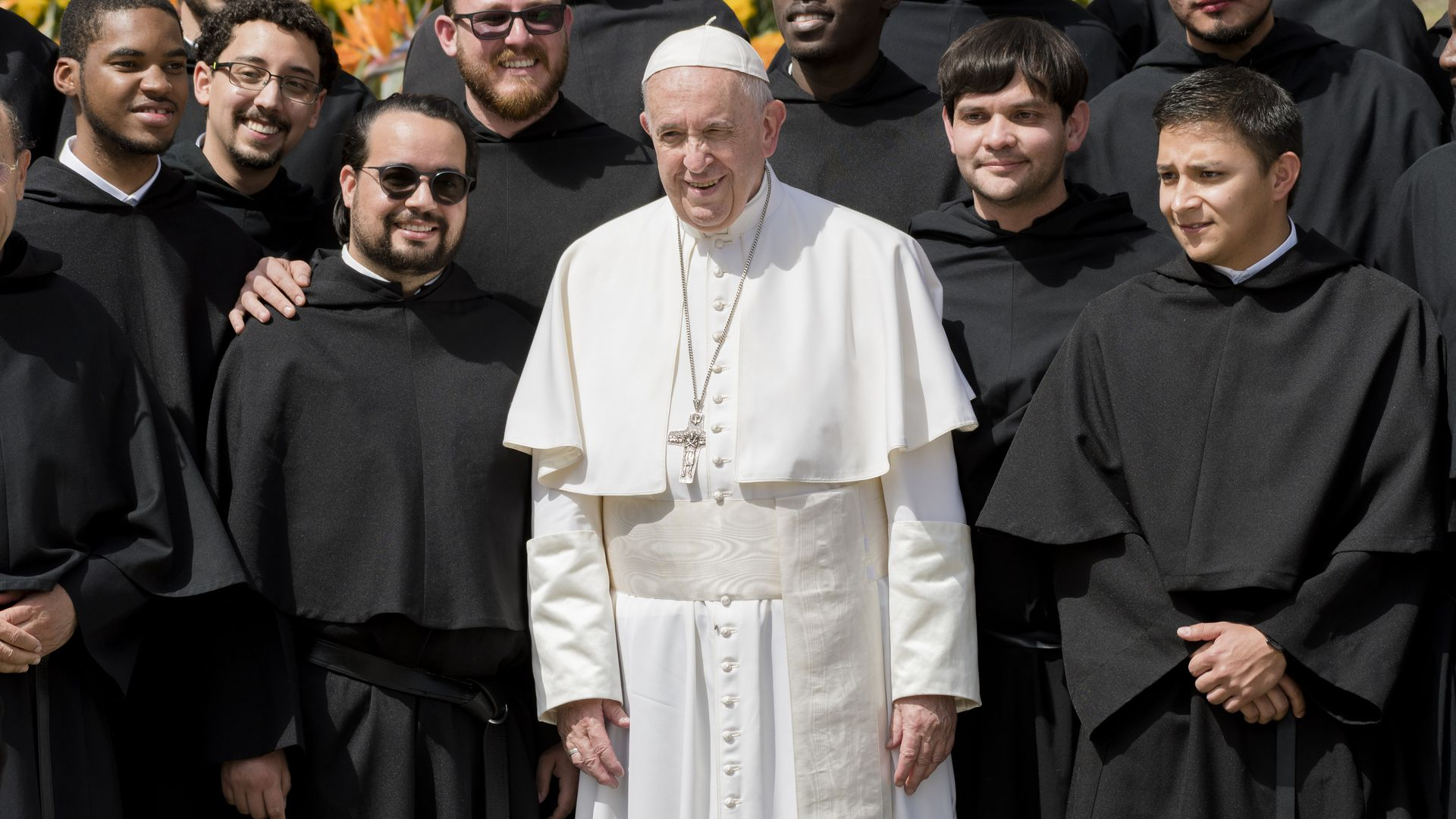 Pope francis standing with priests