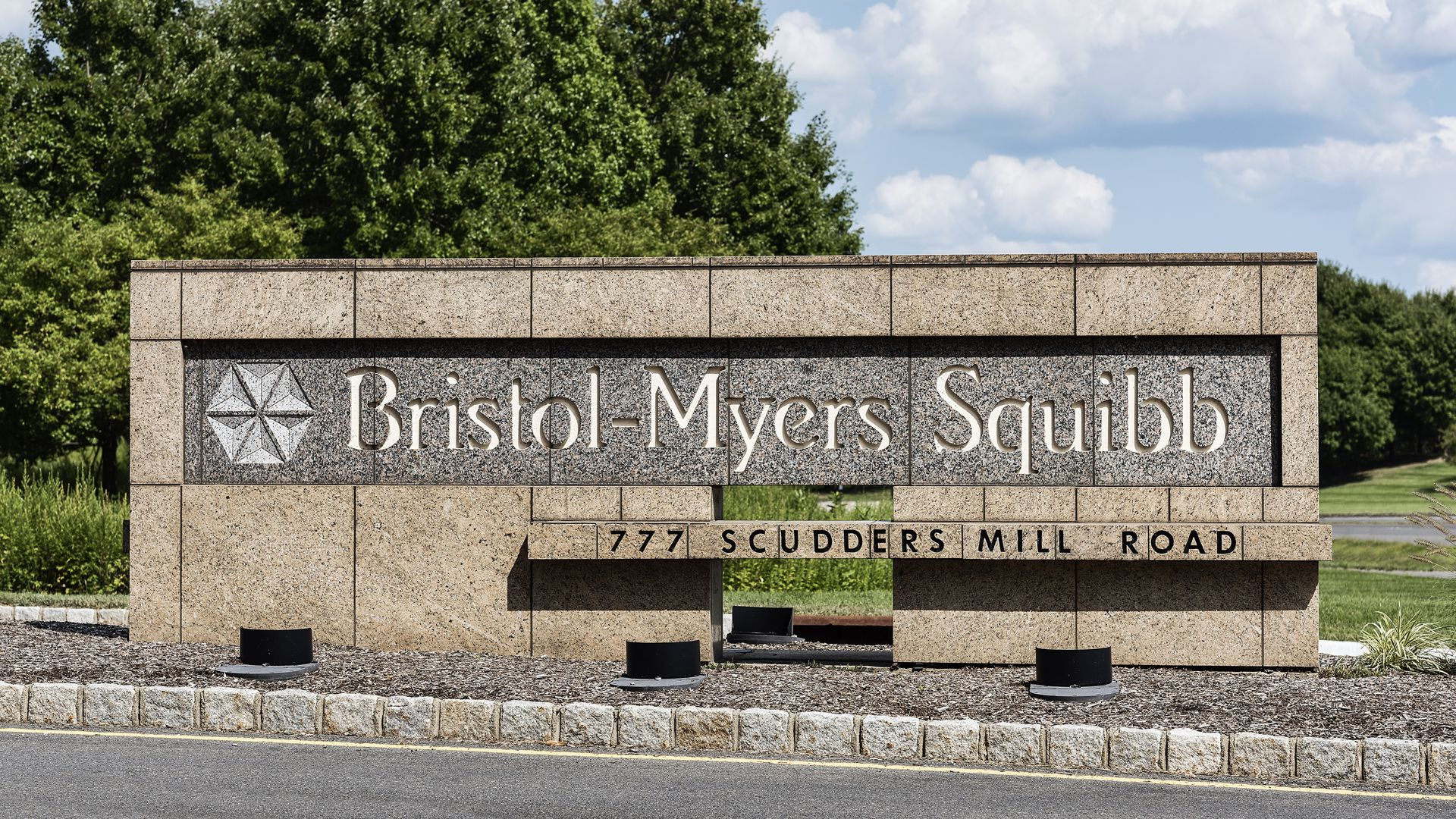 A sign with the Bristol-Myers Squibb name and logo.