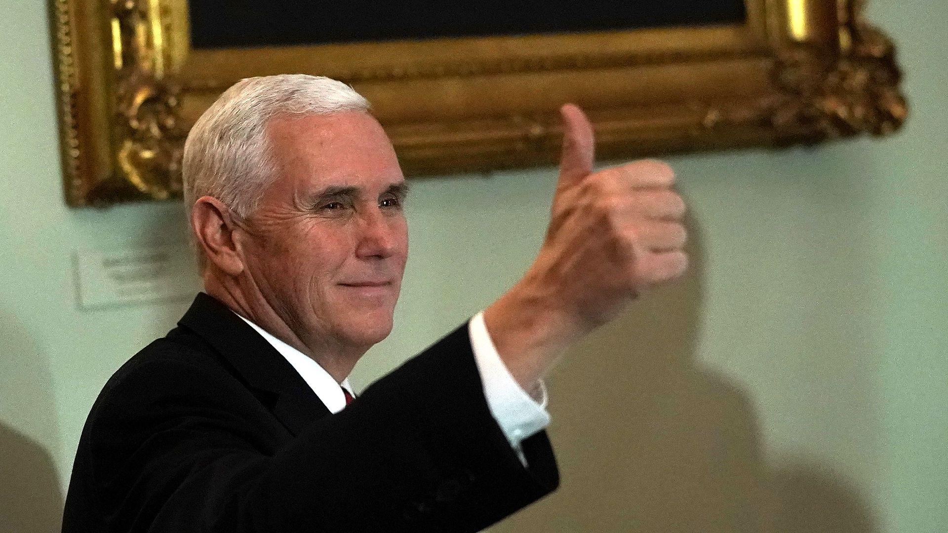 Pence giving a thumbs up