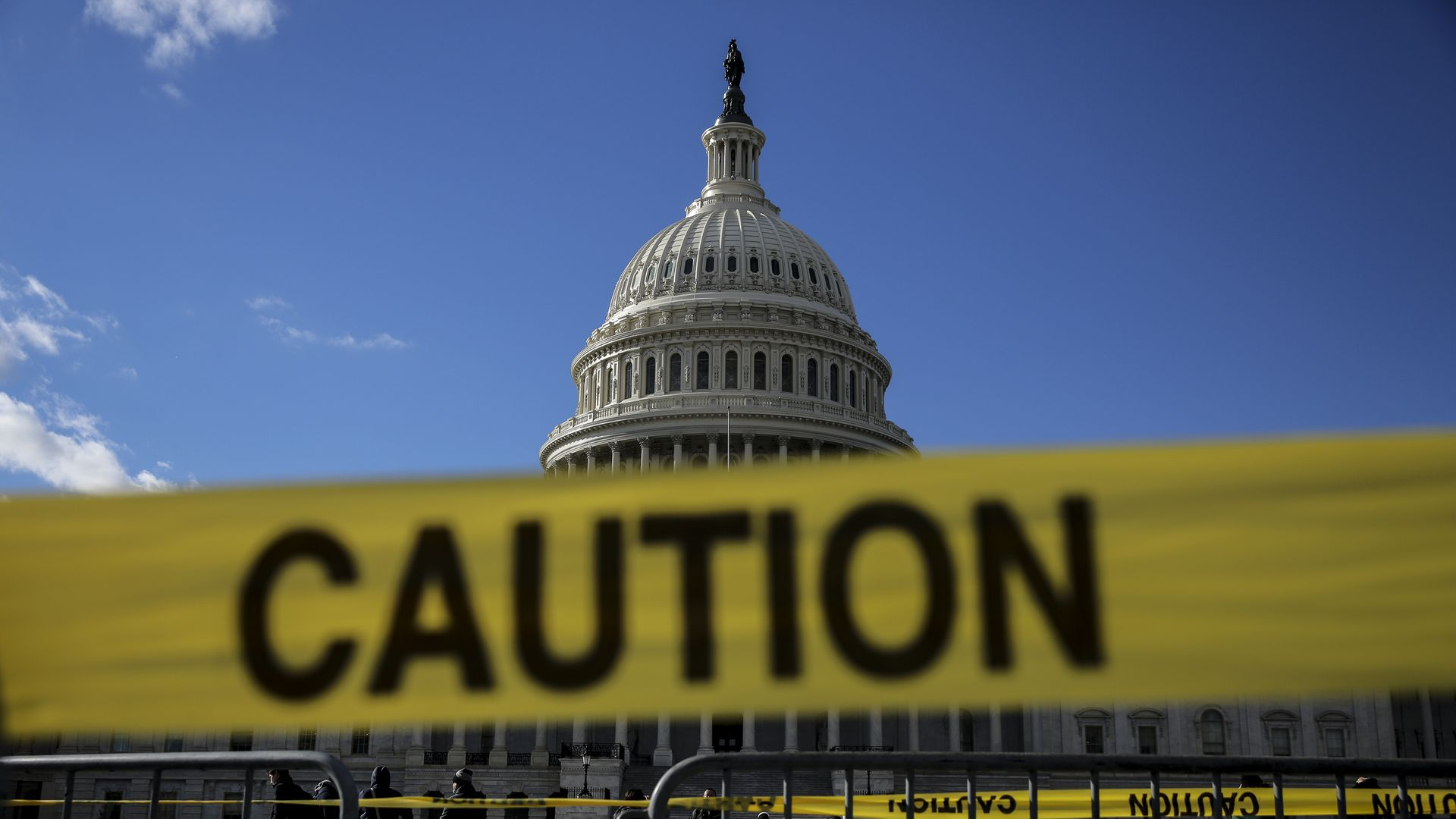 Capitol Hill with caution tape near entrances