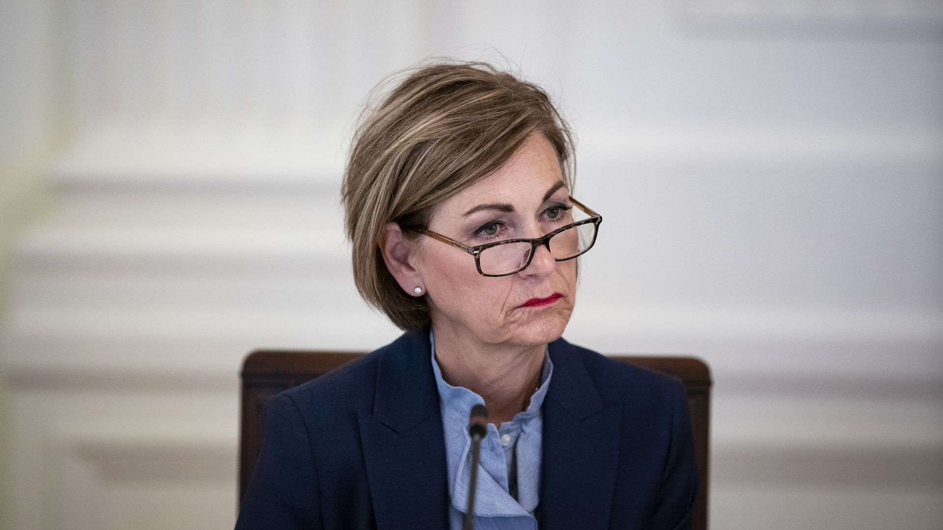 Iowa Gov. Kim Reynolds listens on during a meeting in the White House in 2020.
