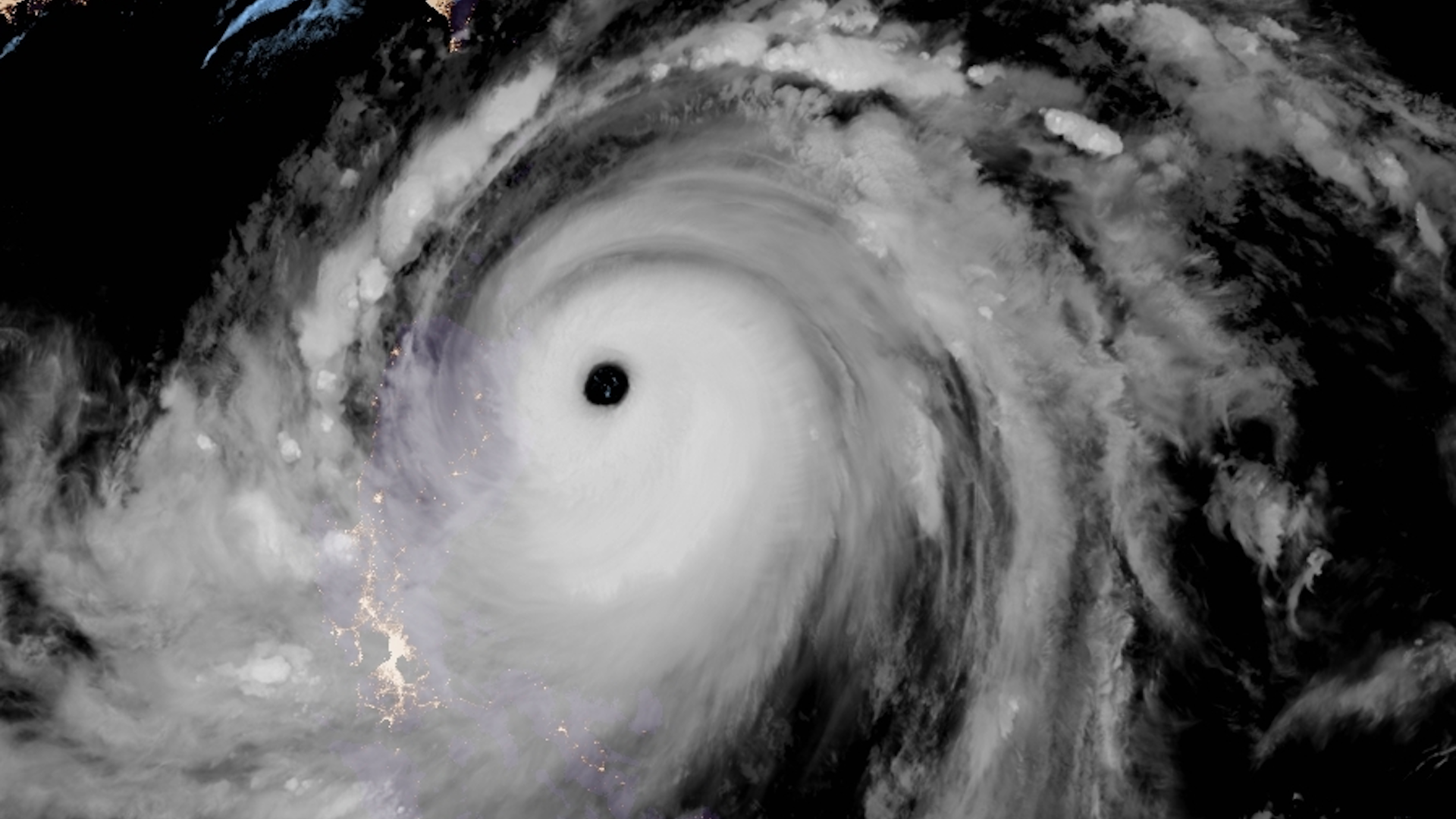 Satellite image showing Super Typhoon Mangkhut nearing landfall in the northern Philippines on Sept. 14, 2018.