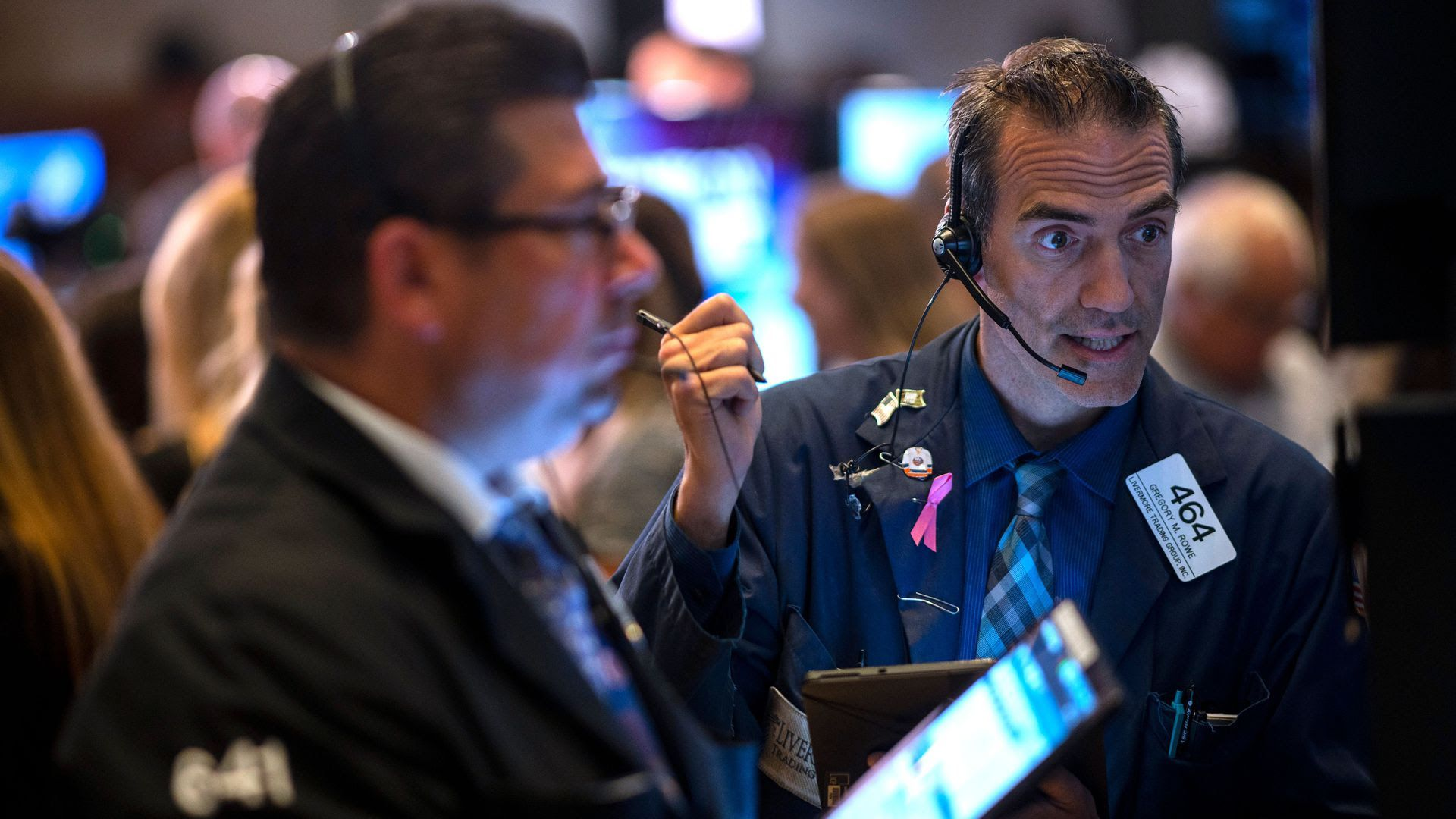 Traders work after the opening bell at the New York Stock Exchange on July 16. Photo: Johannes Eiselle /AFP/Getty Images