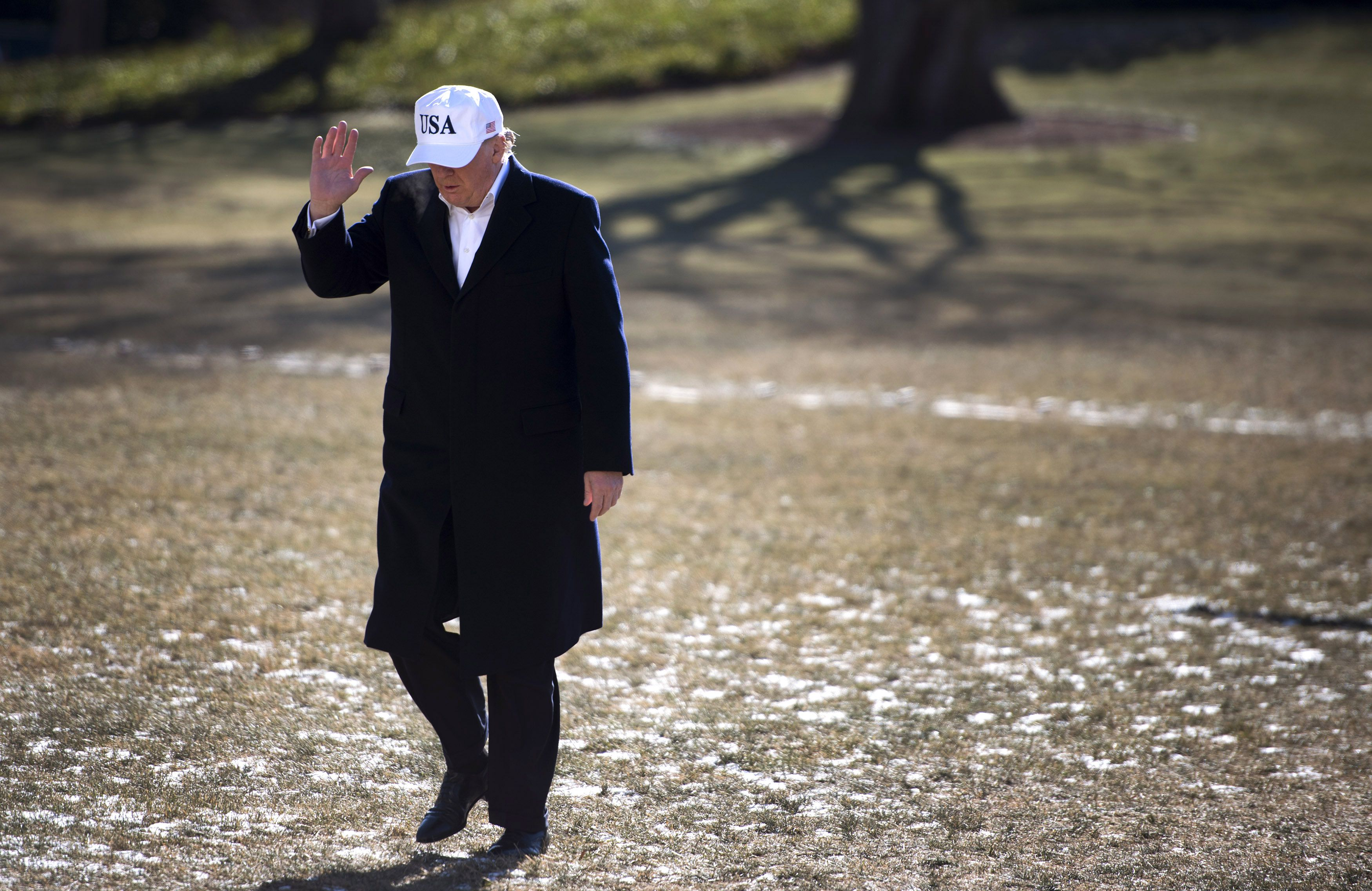 Trump arrives on the South Lawn yesterday, after a weekend at Camp David.  (Kevin Dietsch-Pool/Getty Images)