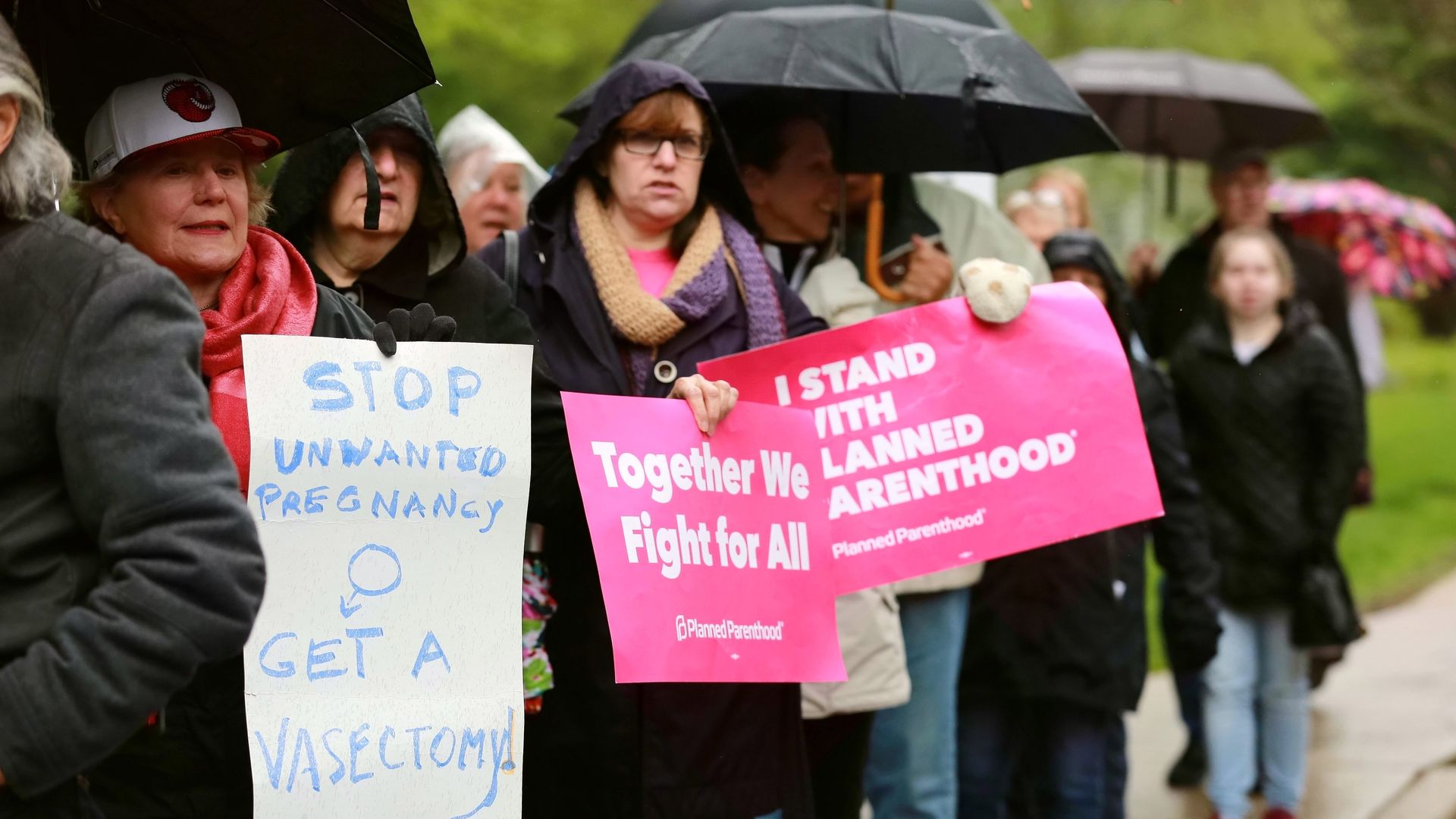 In this image, protestors stand with pro-abortion signs.