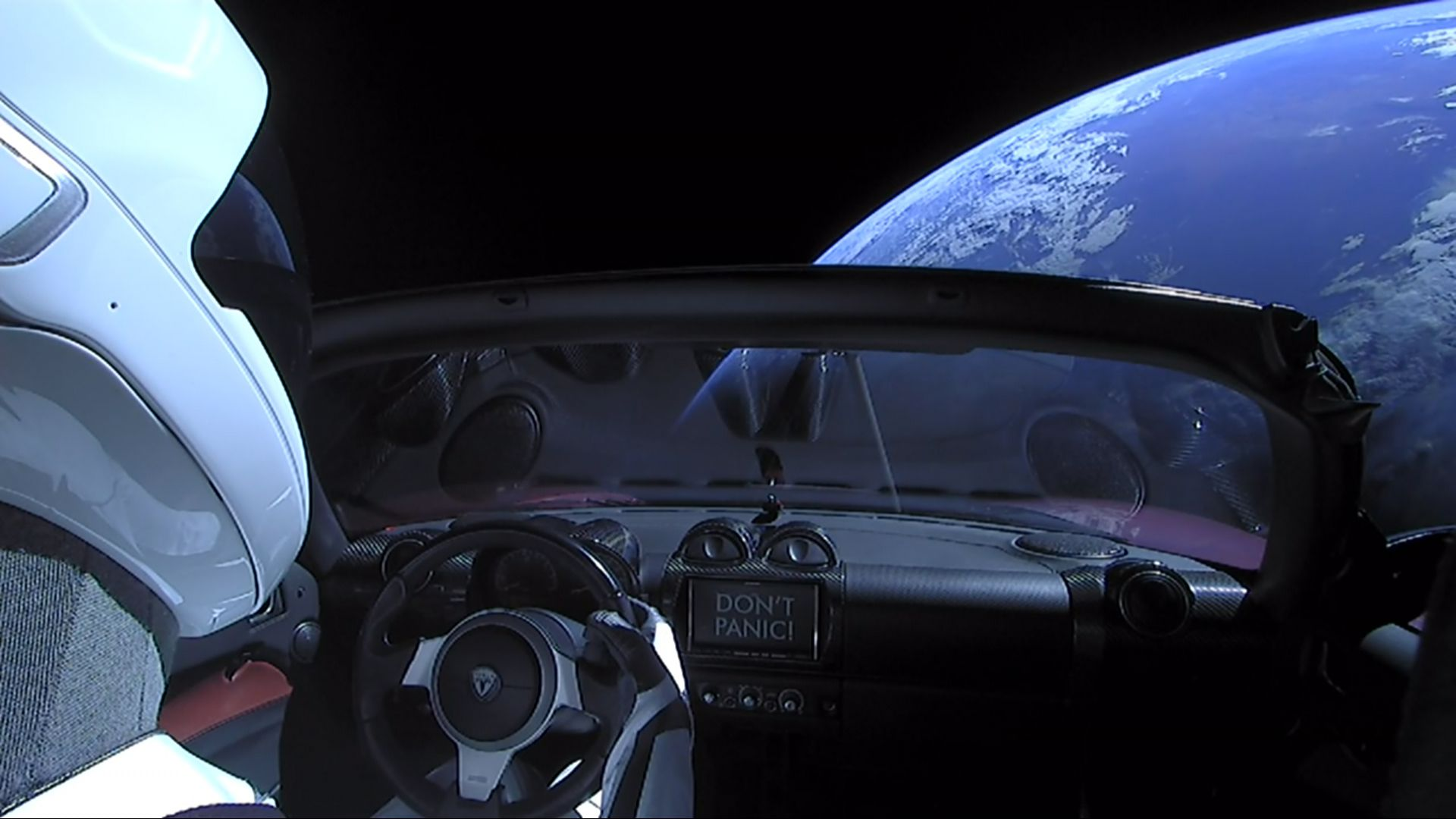 A Tesla roadster launched from the Falcon Heavy rocket with a dummy driver named 'Starman'.