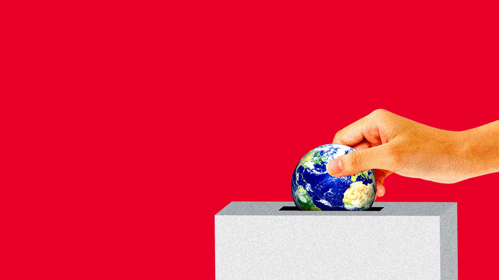 Hand puts in a mini Earth into ballot box.