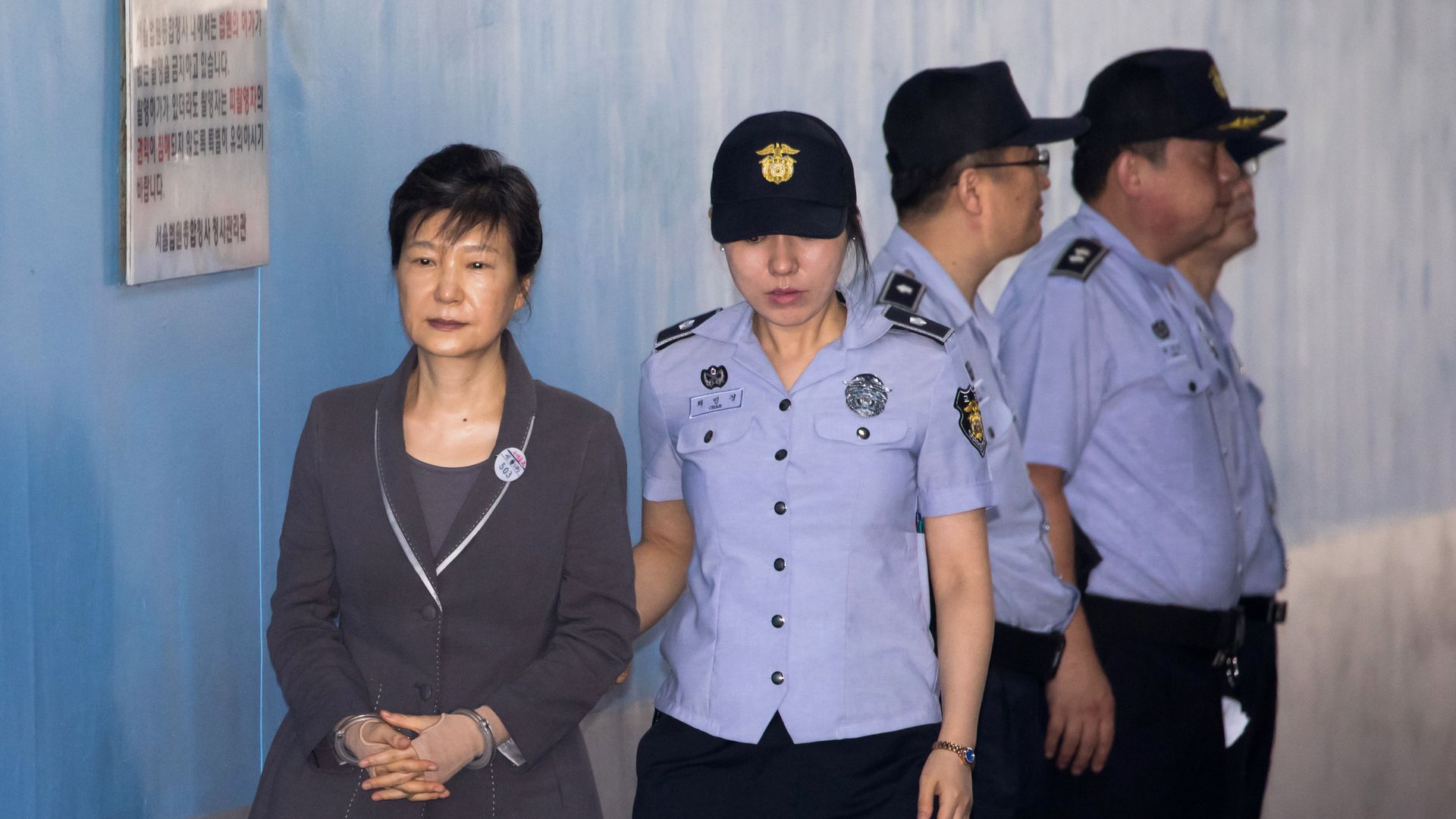 South Korean ex-President Park Geun-hye escorted by a prison guard