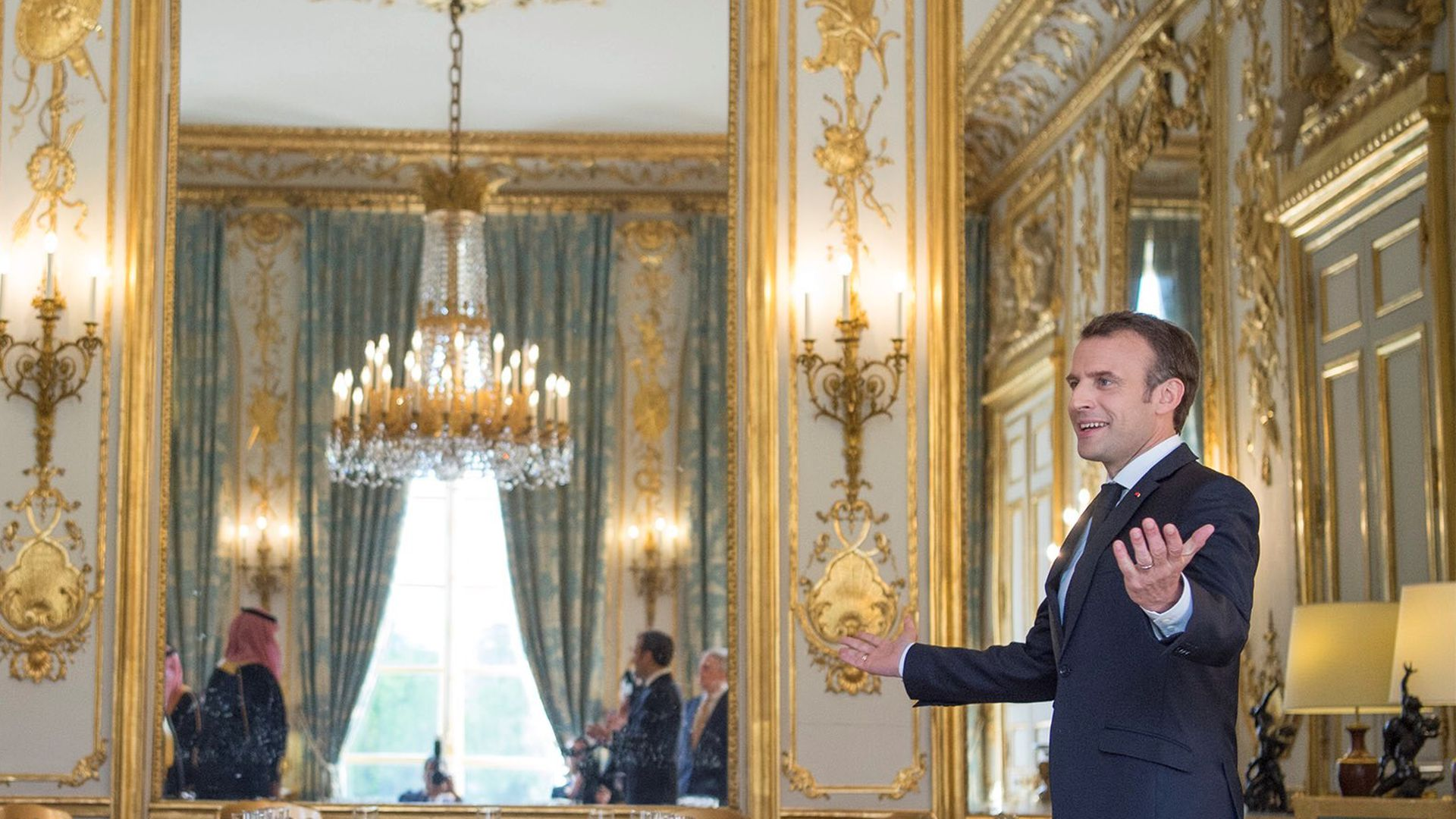 Macron in a palace dining room