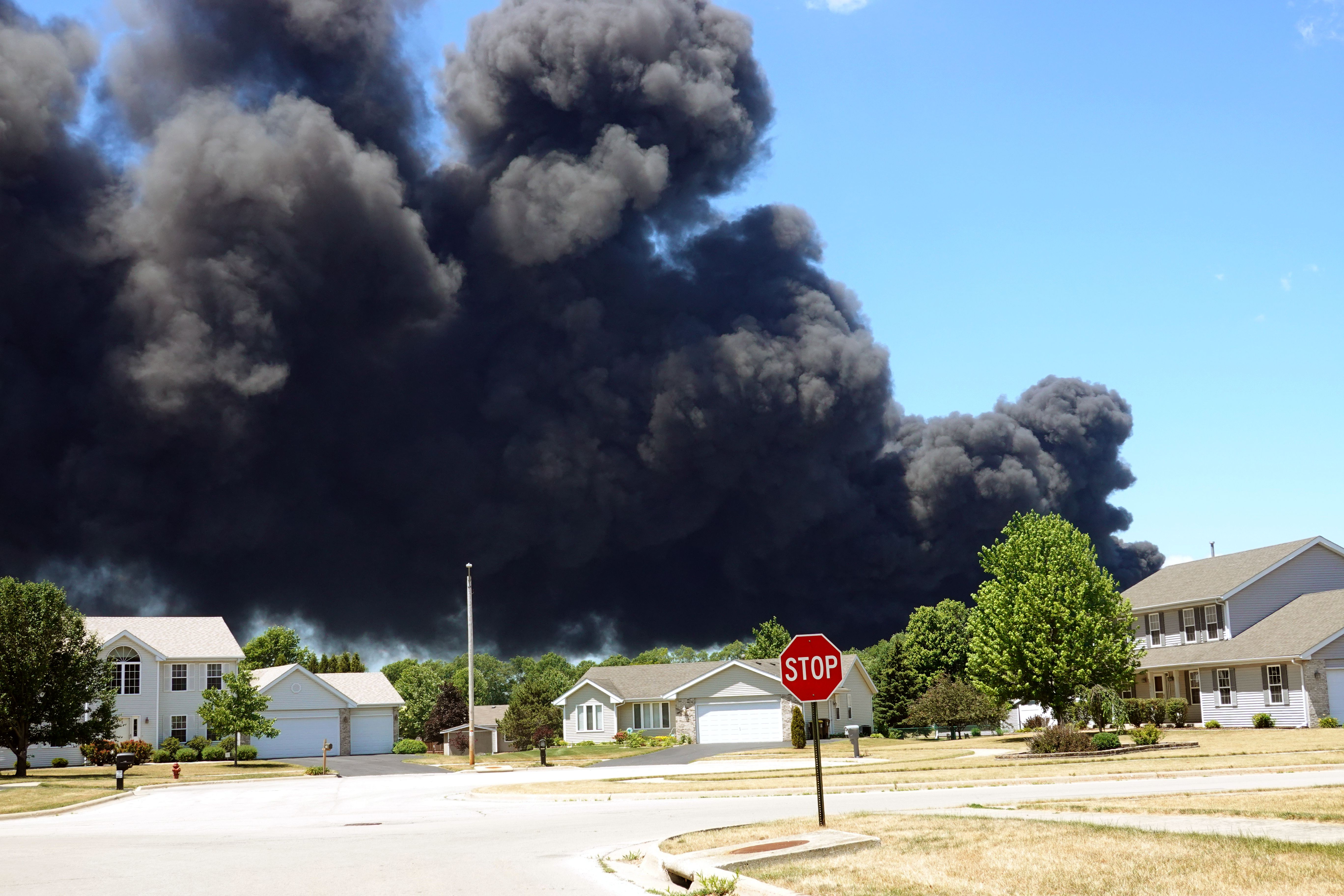 Smoke billows from an industrial fire in Rockton, Ill.