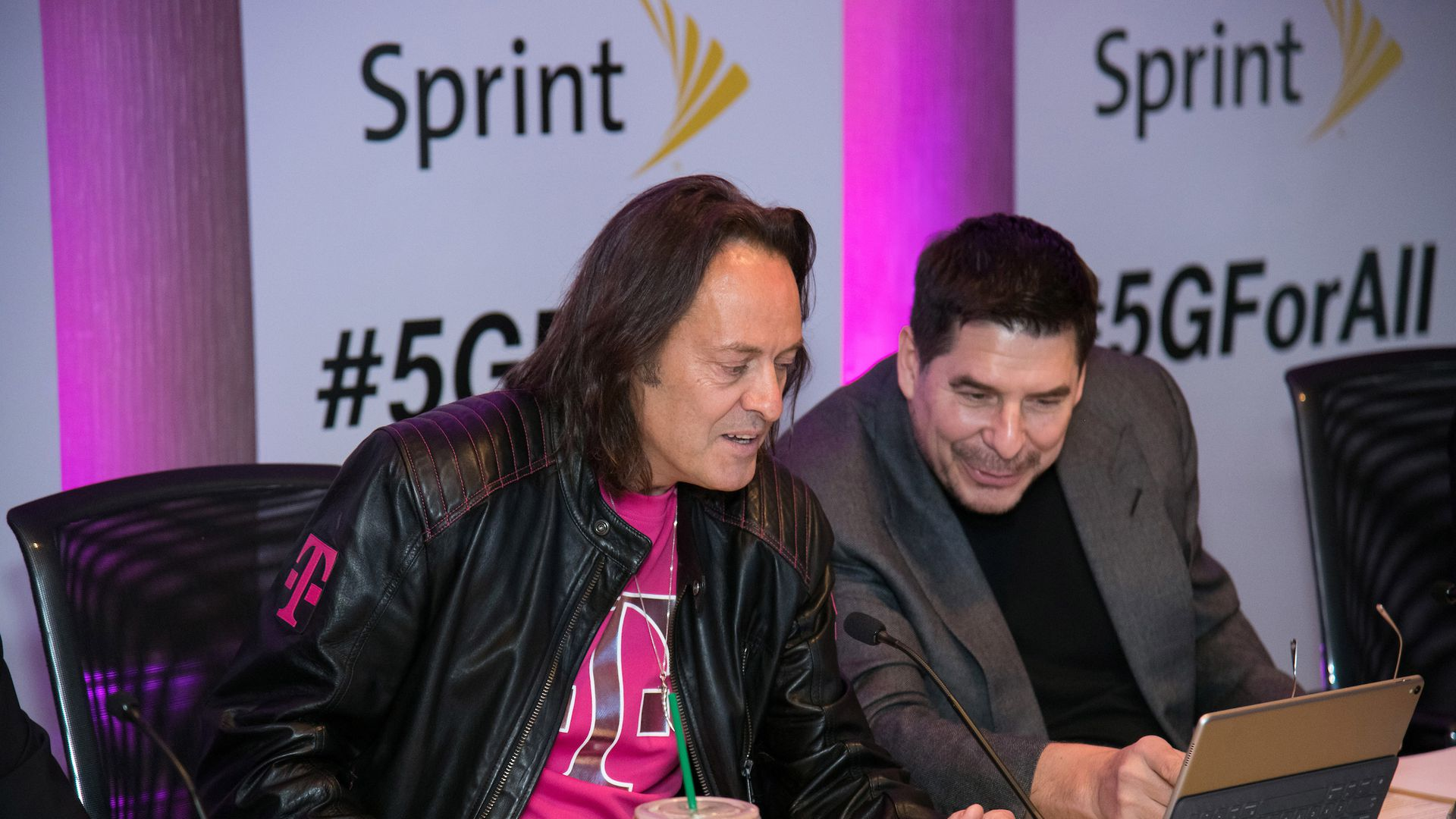 Sprint CEO Marcelo Claure (right), seen here with T-Mobile CEO John Legere.