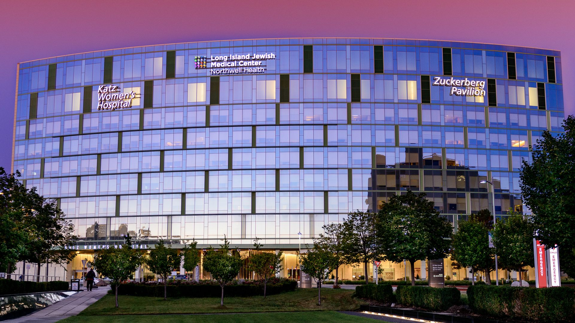 Exterior photo of Long Island Jewish Medical Center hospital with trees and grass in foreground.