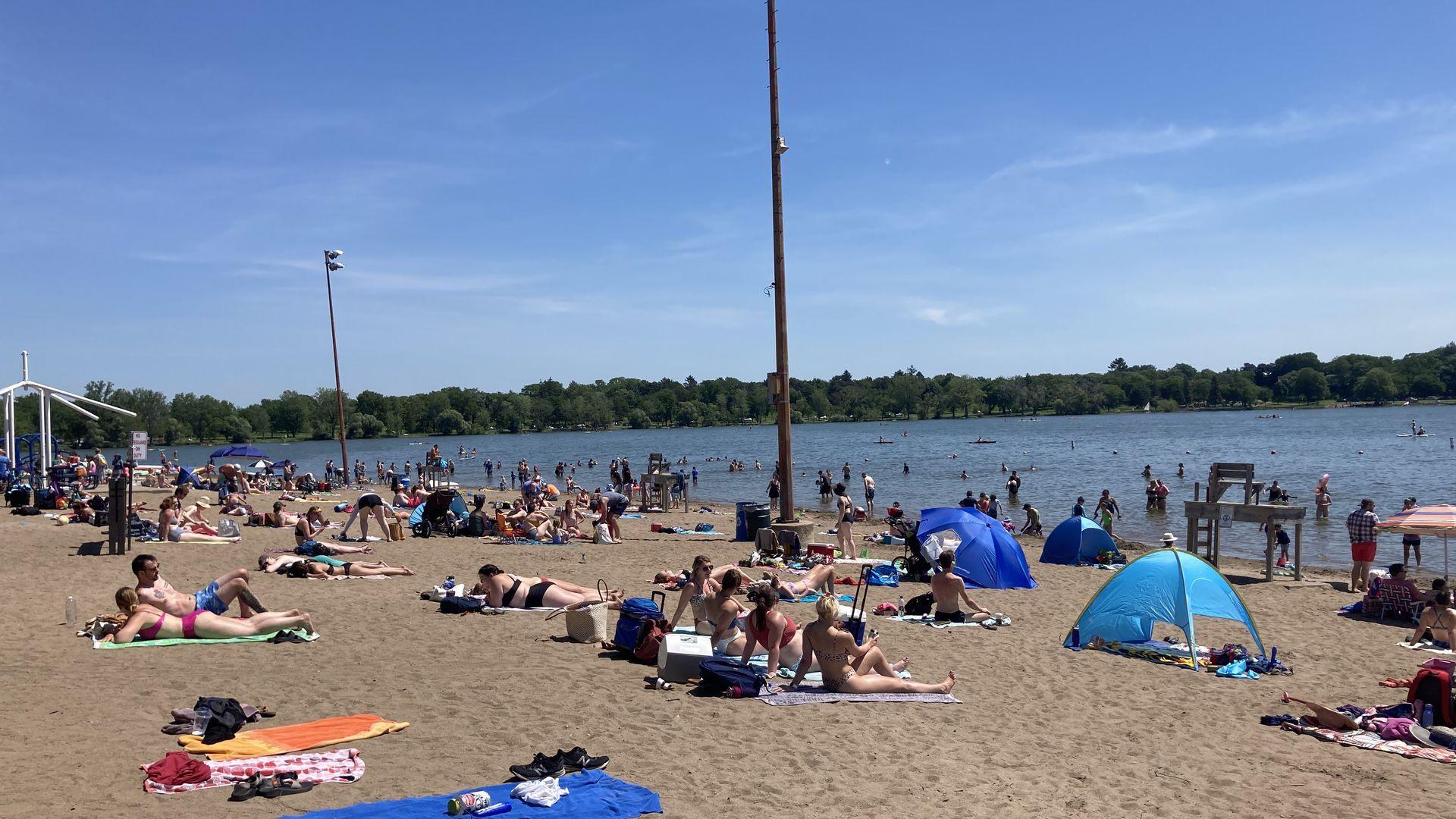 People sunbathe at Minneapolis' Lake Nokomis Beach.