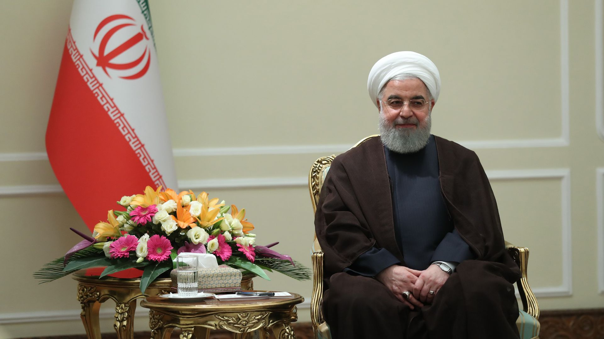 Hassan Rouhani seated in a chair