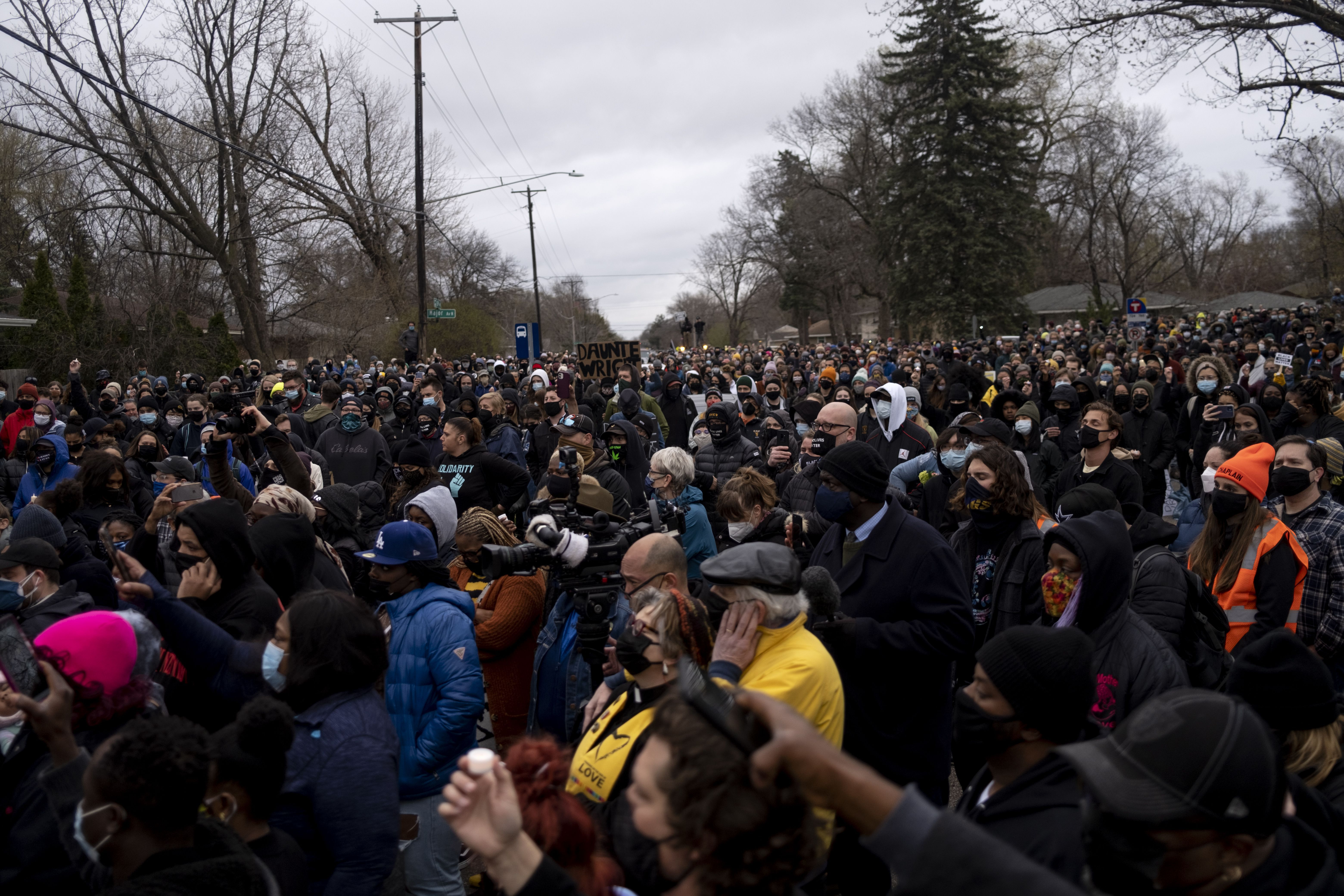 People gather during a vigil for Daunte Wright in Brooklyn Center, Minnesota, April 12.