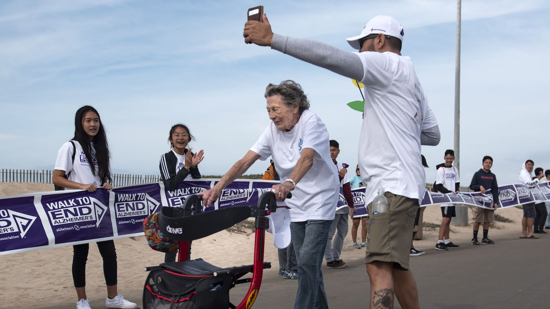 A man records the 2-mile Walk to End Alzheimer's finish in Huntington Beach on Saturday, October 6, 2018.