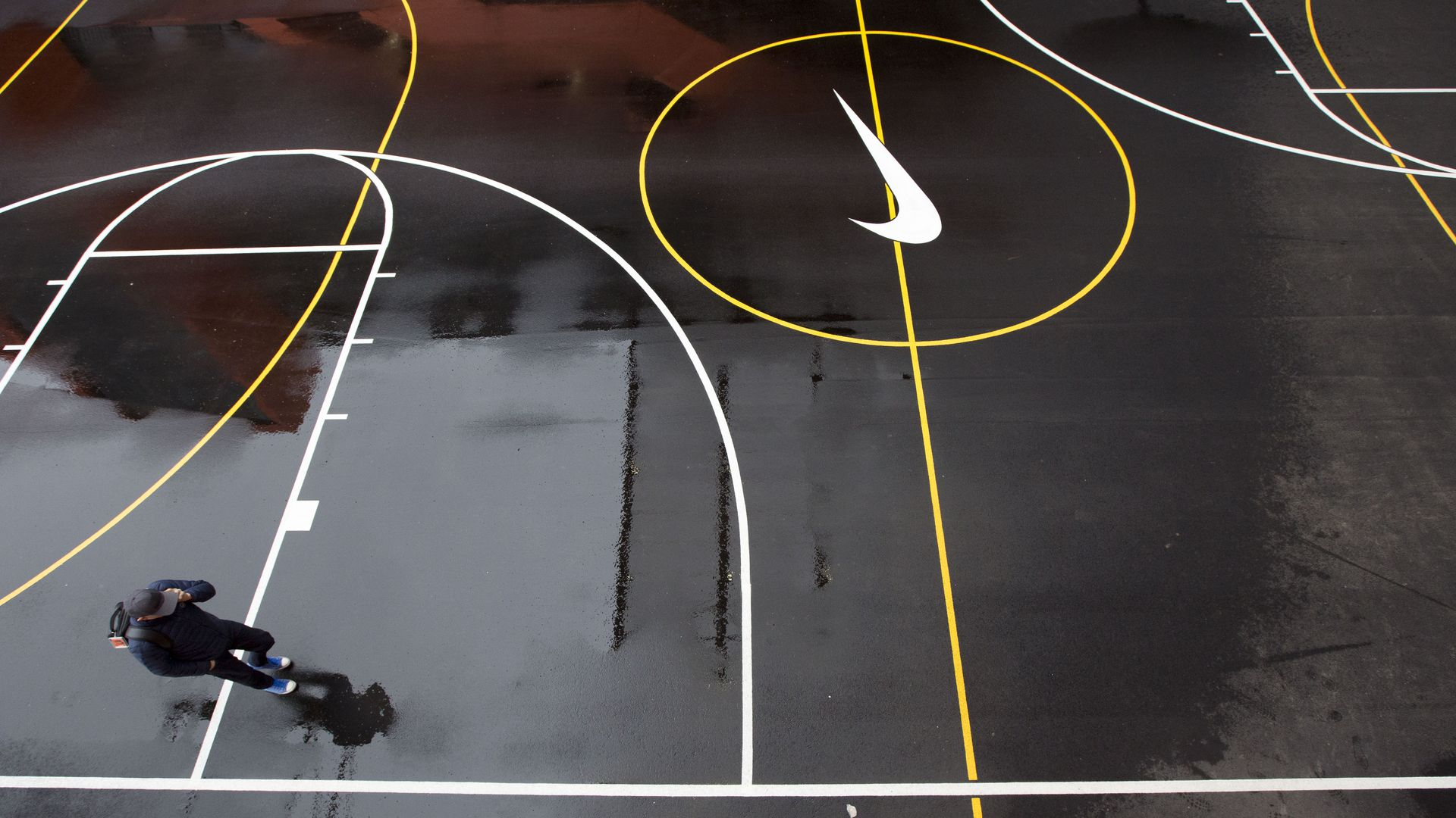 A man walks on a basketball court at Nike headquarters.