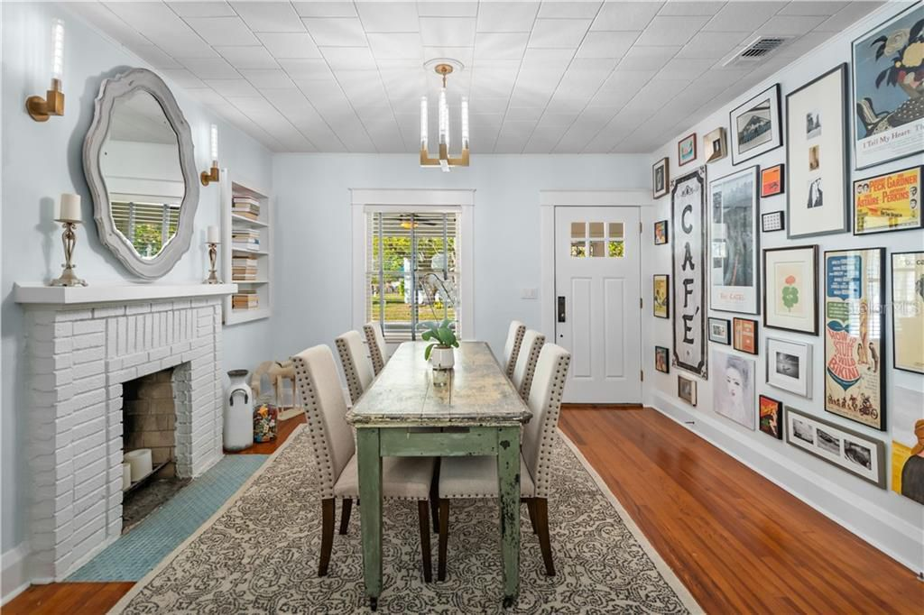 1213 E Henry Ave. interior dining room with cozy brick fireplace