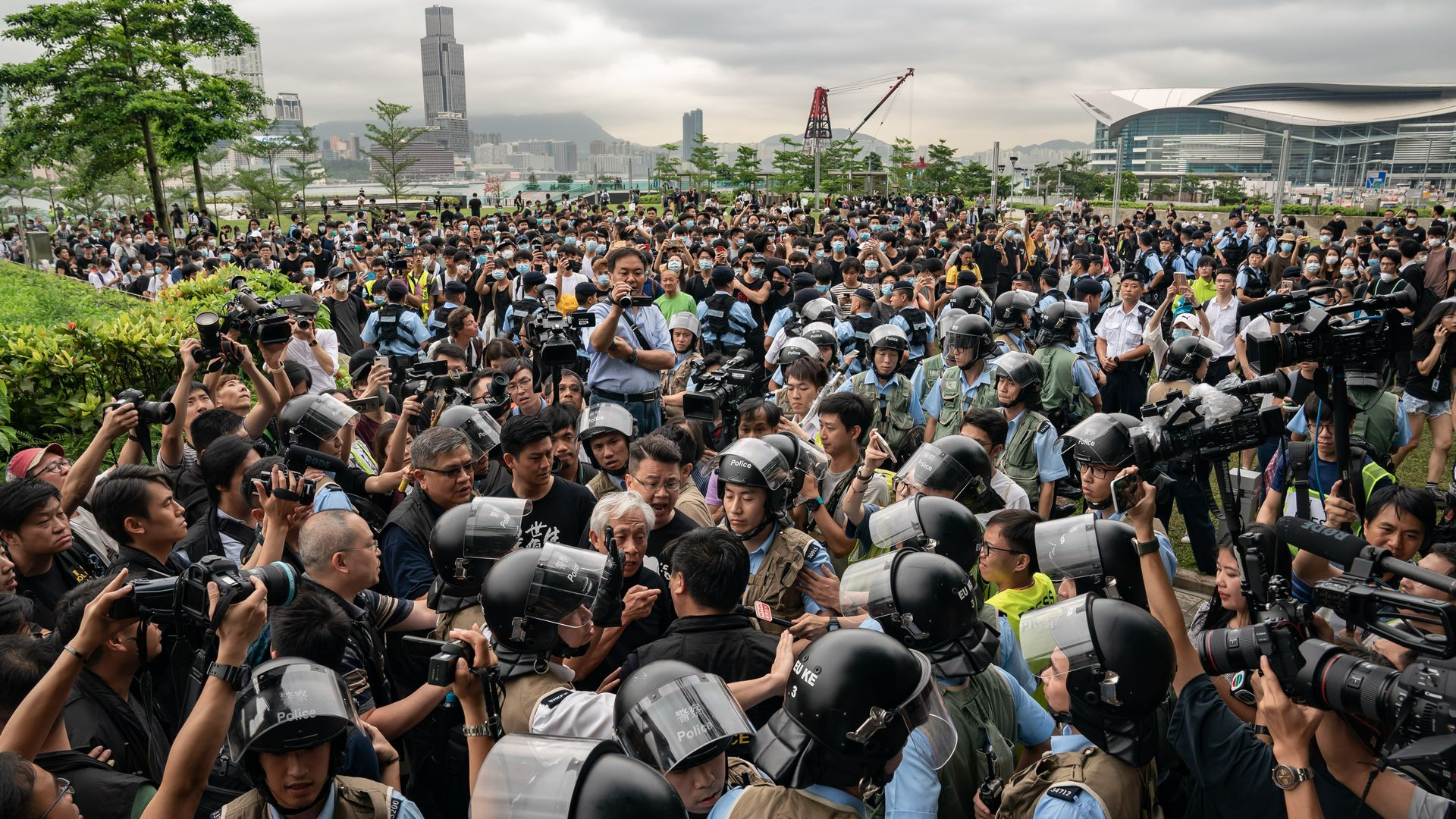 esidents argue with police officers at the Tamar Park outside the Central Government Complex on June 13, 2019 in Hong Kong.
