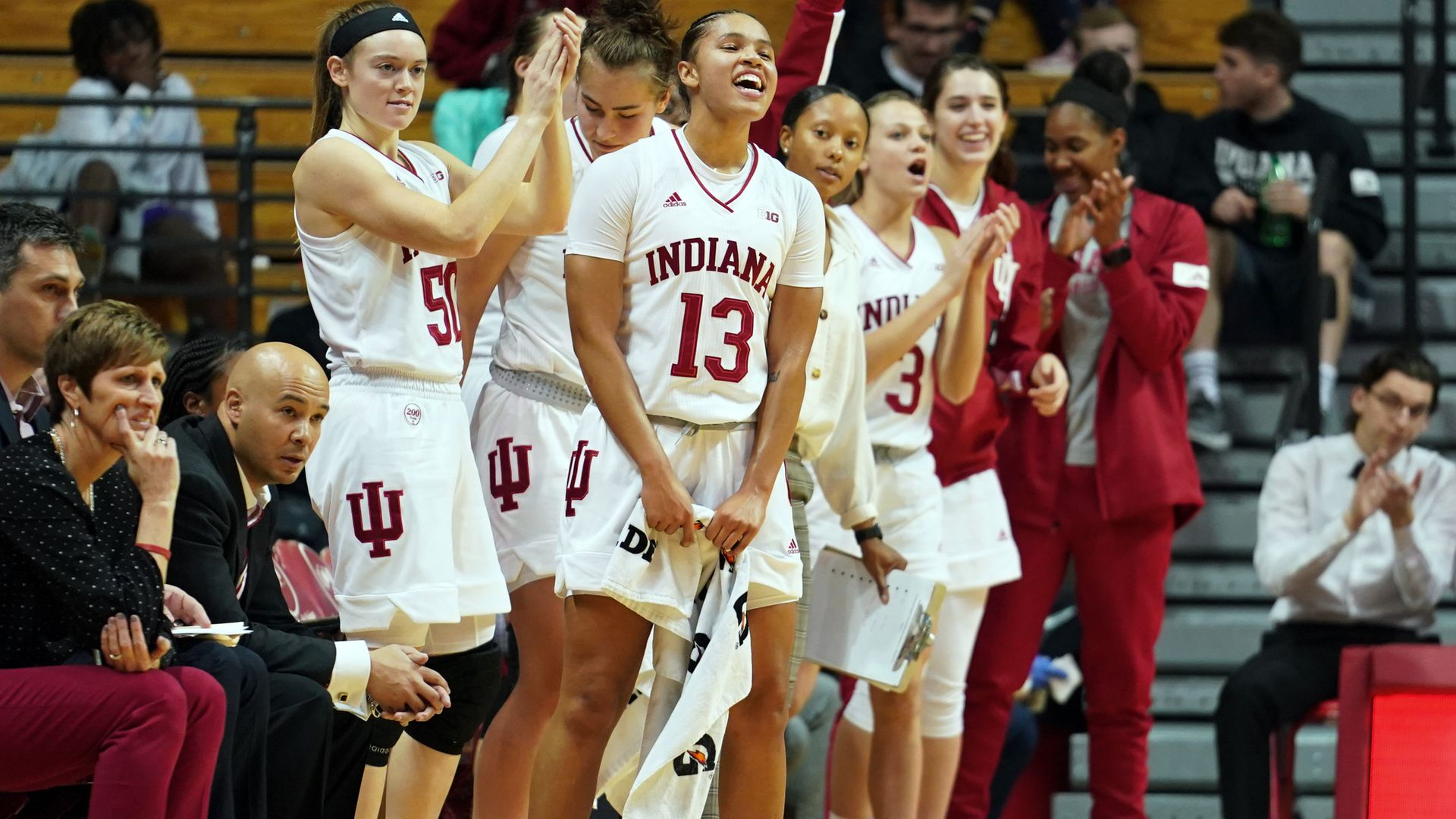 The Indiana Hoosiers celebrate after the NCAA Women's College Basketball game