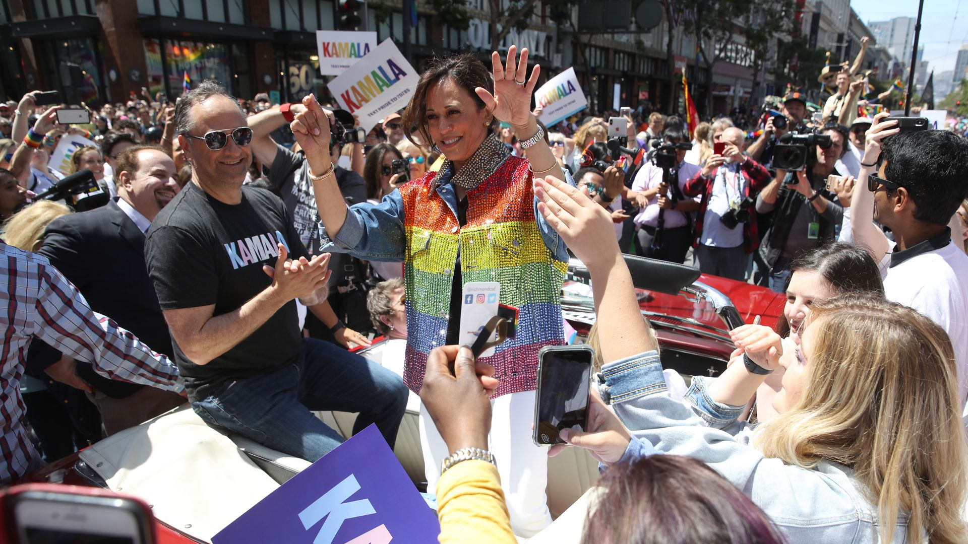Democratic presidential candidate U.S. Sen. Kamala Harris (D-CA) waves as she rides in a car during the SF Pride Parade on June 30, 2019 in San Francisco, California.
