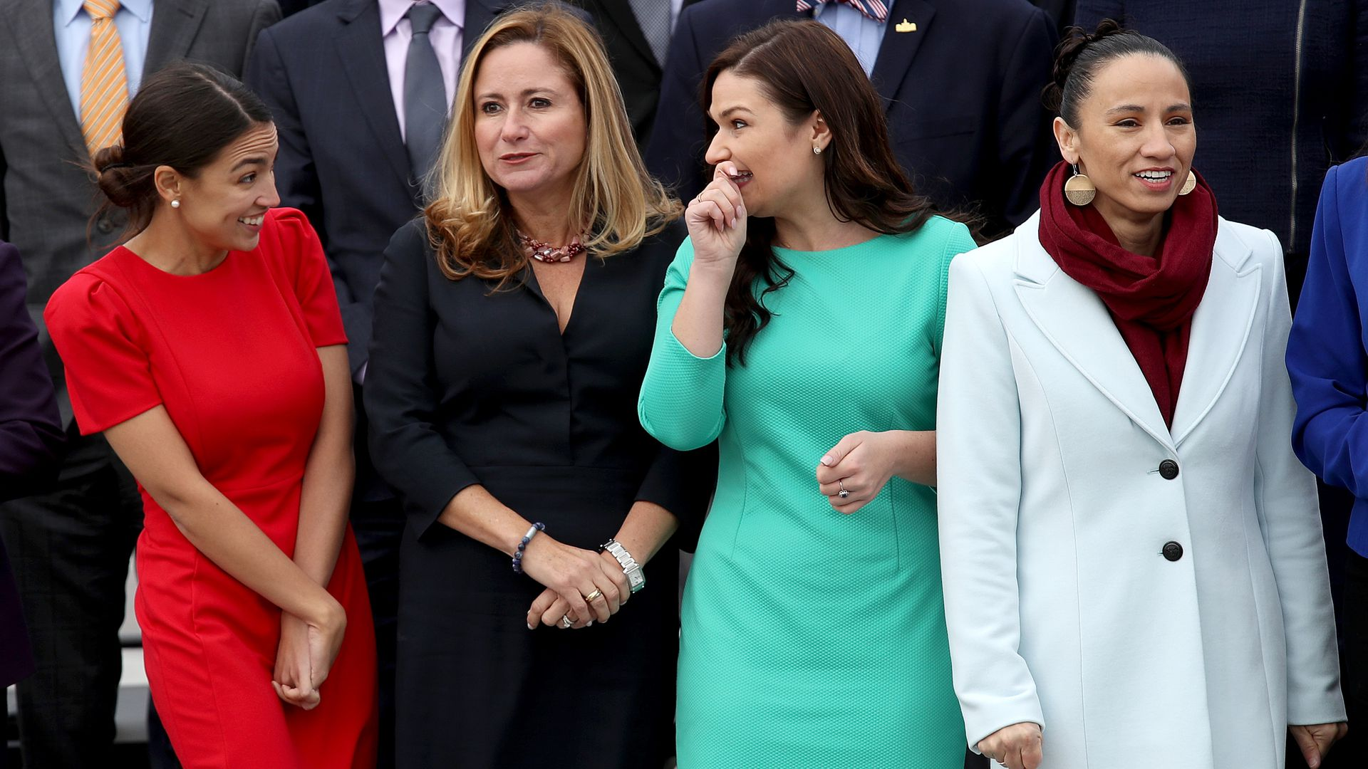 Alexandria Ocasio-Cortez, Debbie Mucarsel-Powell, Abby Finkenauer, and Sharice Davids pose for a picture at the U.S. Capitol.