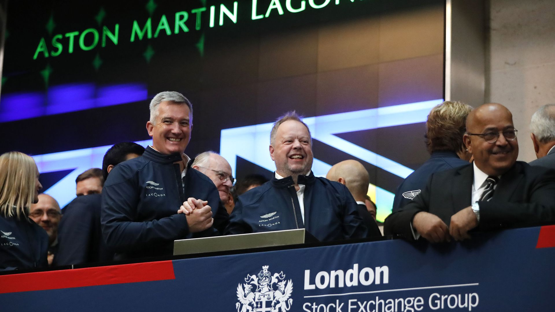 Aston Martin executives celebrate at London Stock Exchange