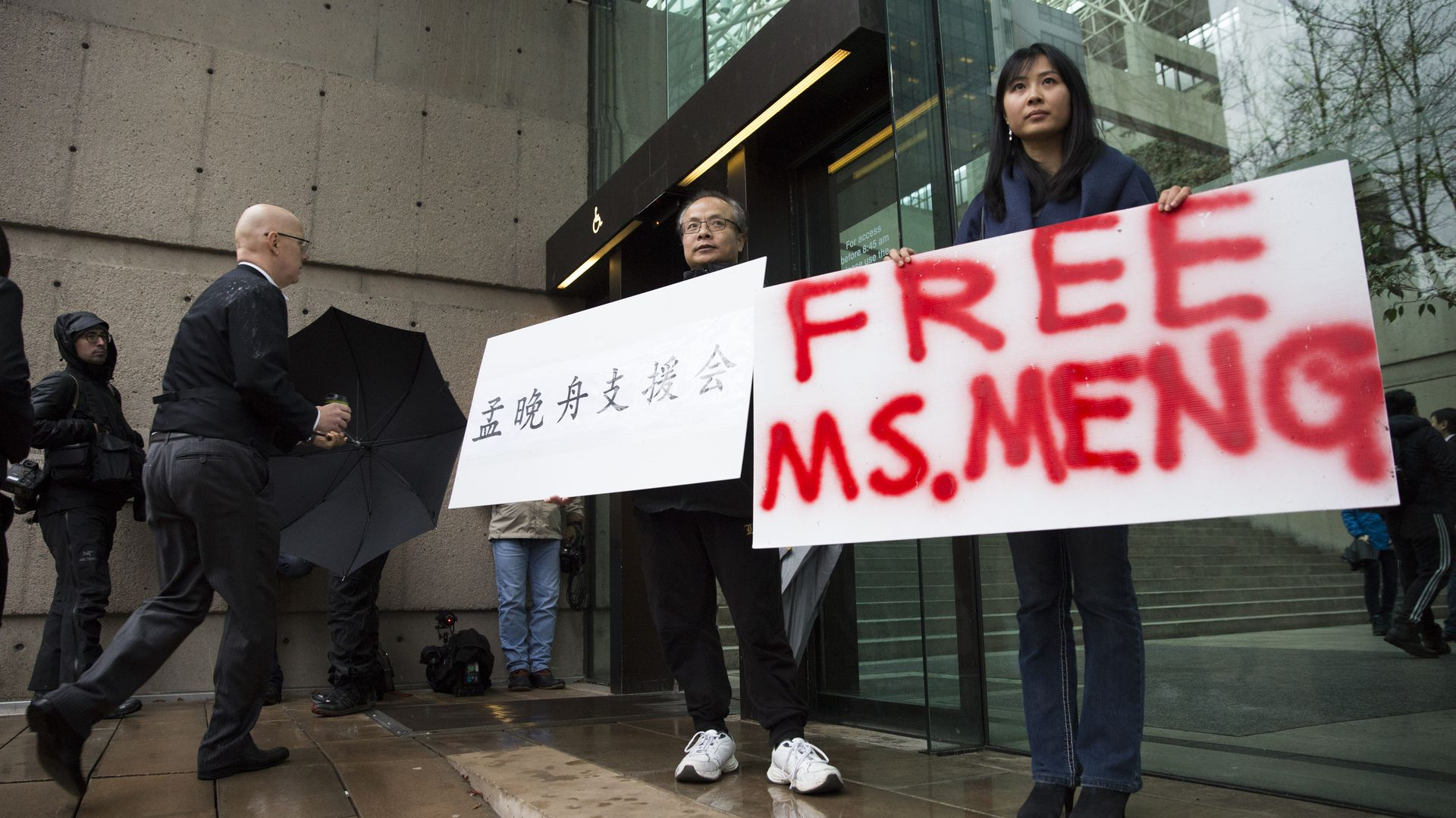 Someone with a poster that says free Ms. Meng